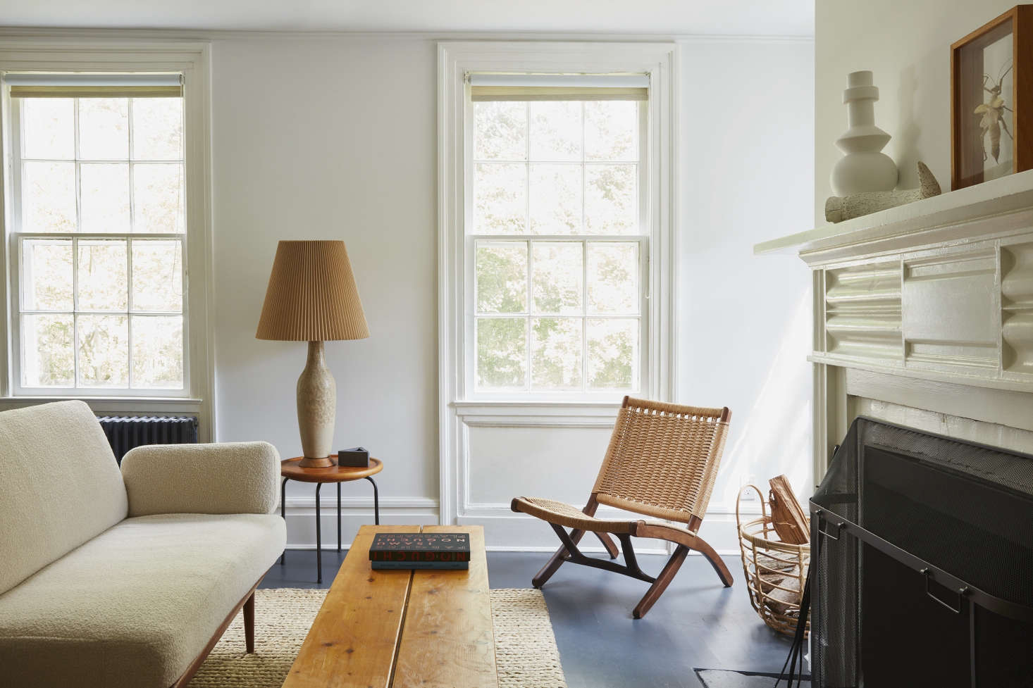 Navy floors in A Colonial House in Bellport with Uncommon Style from French Designer C. S. Valentin. Styling by Alexa Hotz and photography by Jonathan Hökklo for Remodelista.