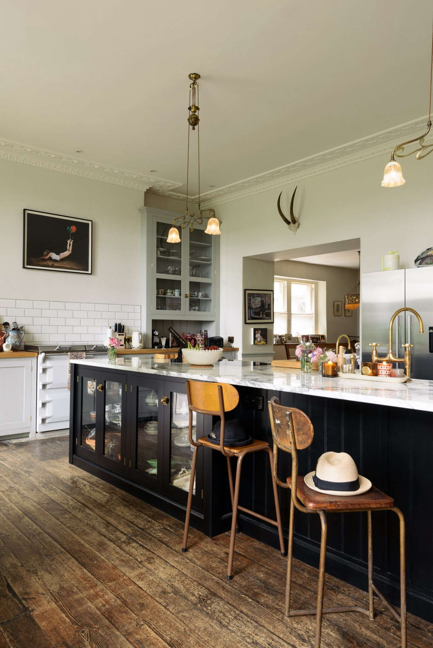 "According to Parker, deVOL delivered a ""classic English kitchen with a twist."" It was Lowe's idea to add glazing to the lower cupboards and to paint only the island black—ideas that deVOL is now applying in future kitchens."