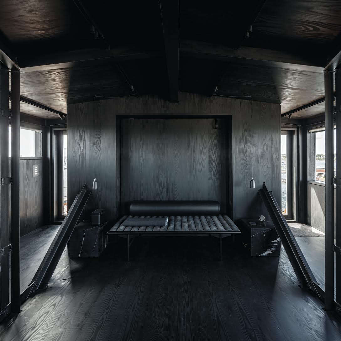 Alexa is admiring the Dinesen Douglas planks (finished with custom Megablack oil) in aconverted coal cranein Copenhagen&#8