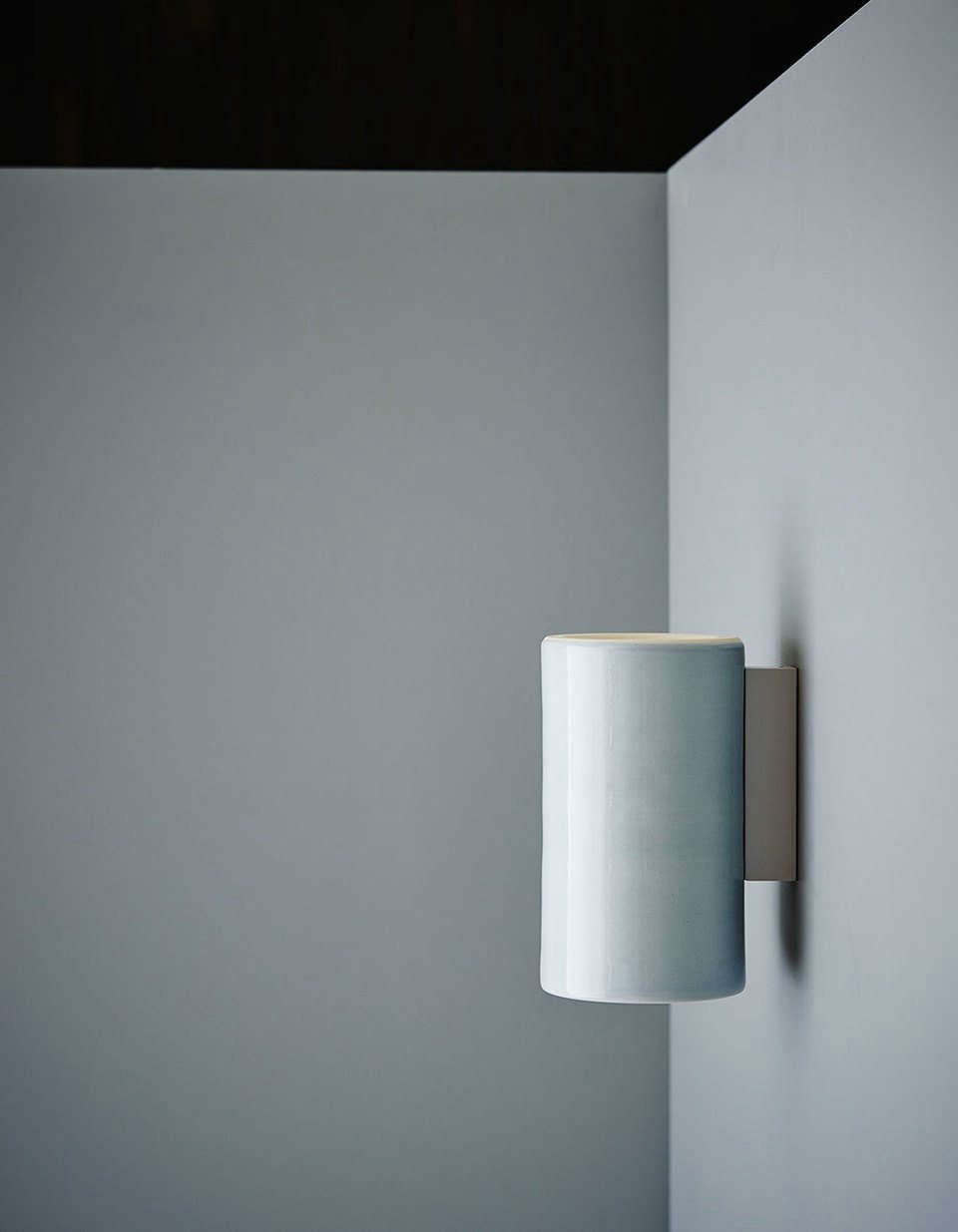 The Earth Wall Light in a dove gray glaze finish.