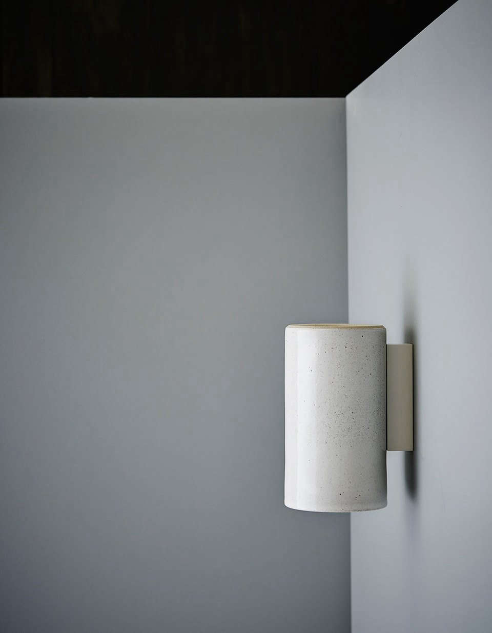 The Earth Wall Light in speckled white.