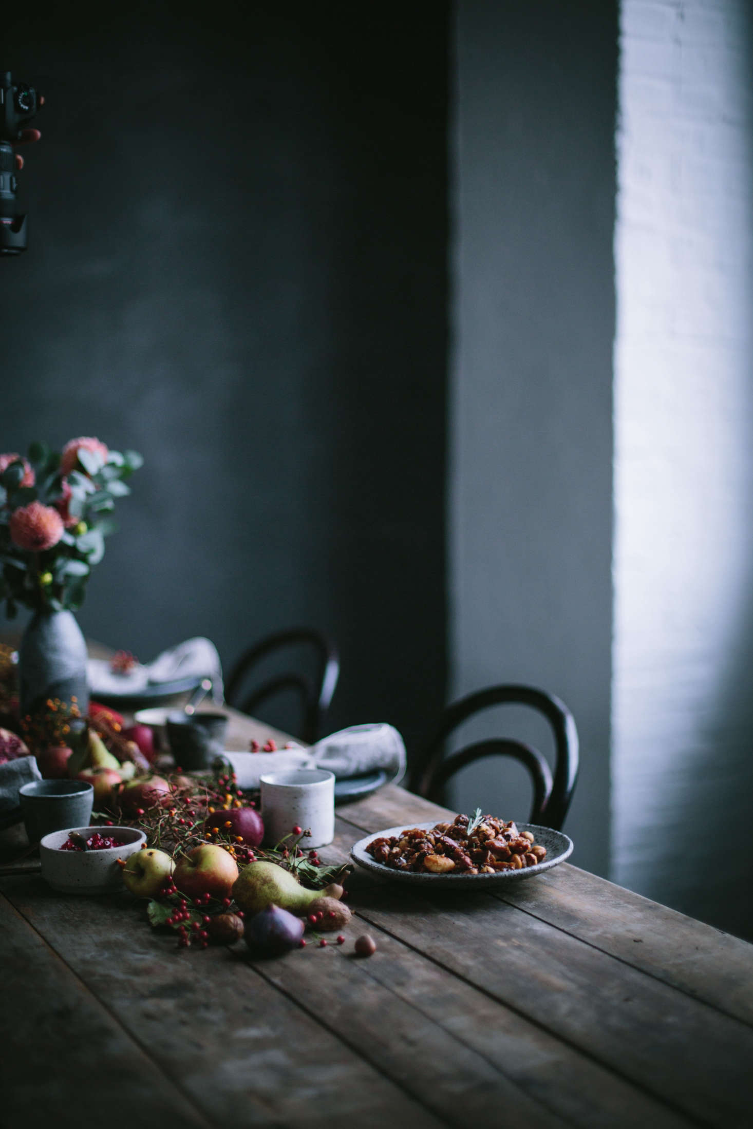 A dark fall tablescape by Flores and Our Food Stories.