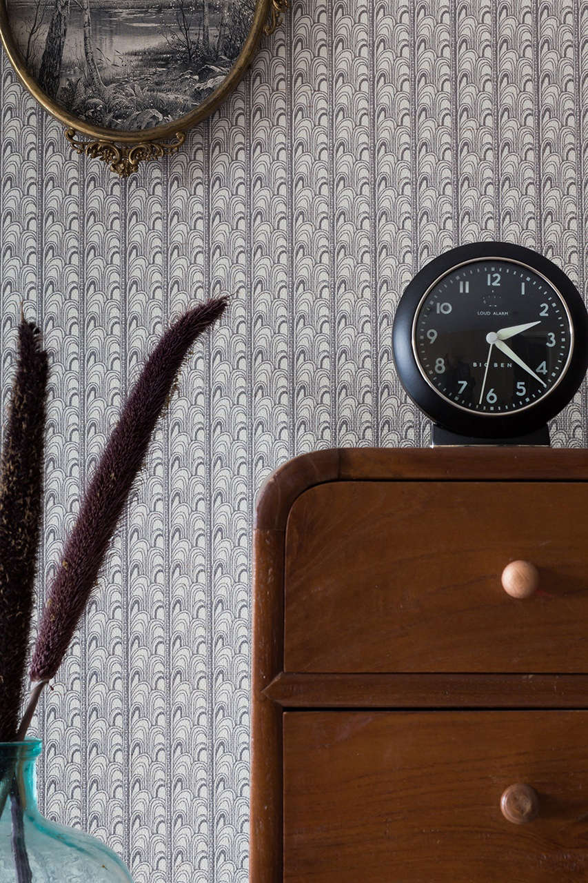 The intricate detail of the Deco Grasscloth Wallpaper($5 per yard), shown here in Charcoal, is &#8