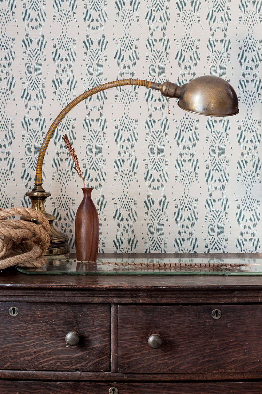 Dash Grasscloth Wallpaper($5 per yard), shown here in Dark Teal and hand-drawn on paper-backed woven sisal, is &#8