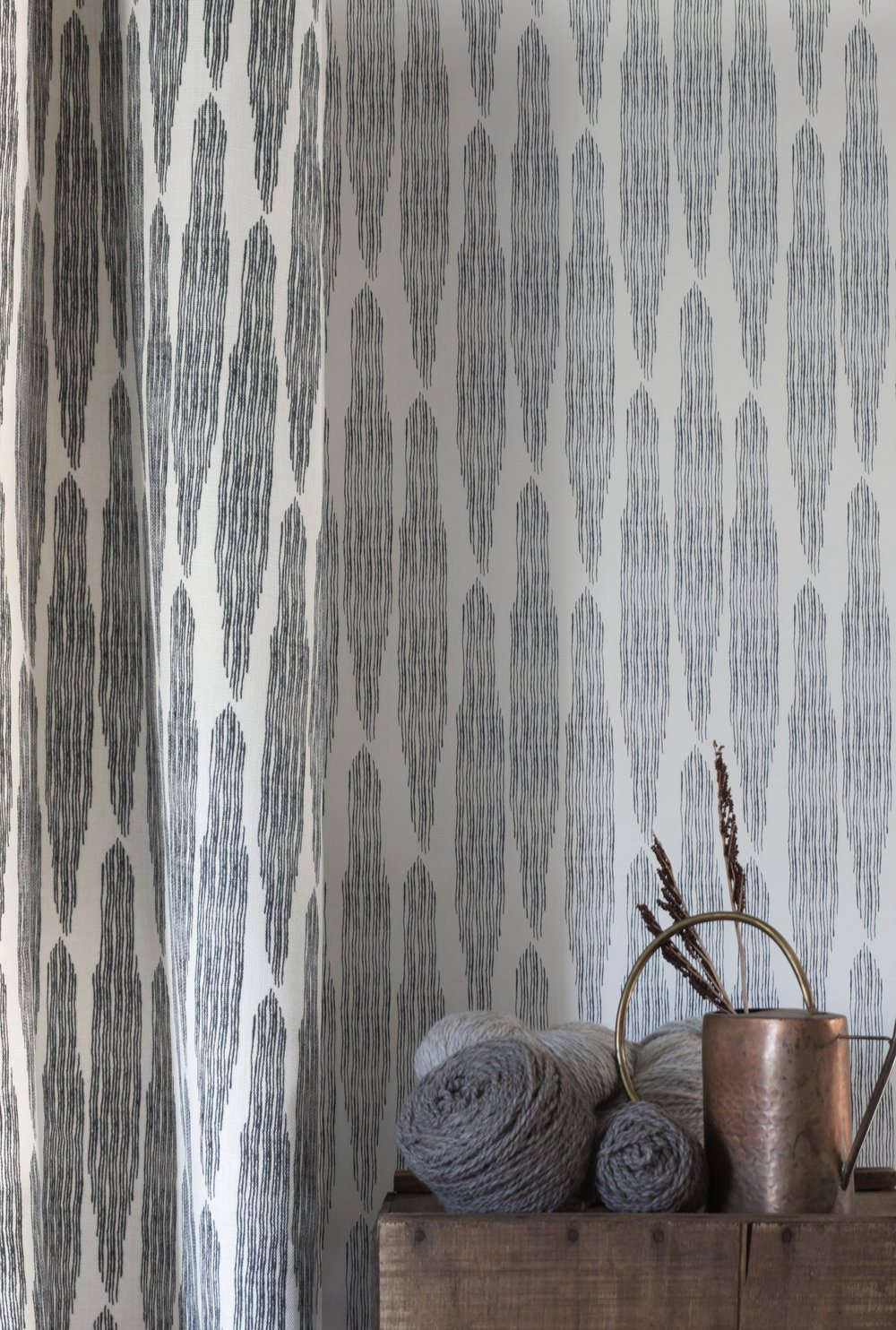 Pines Wallpaper($65 per yard), shown here in Midnight, is reminiscent of cold New England: &#8