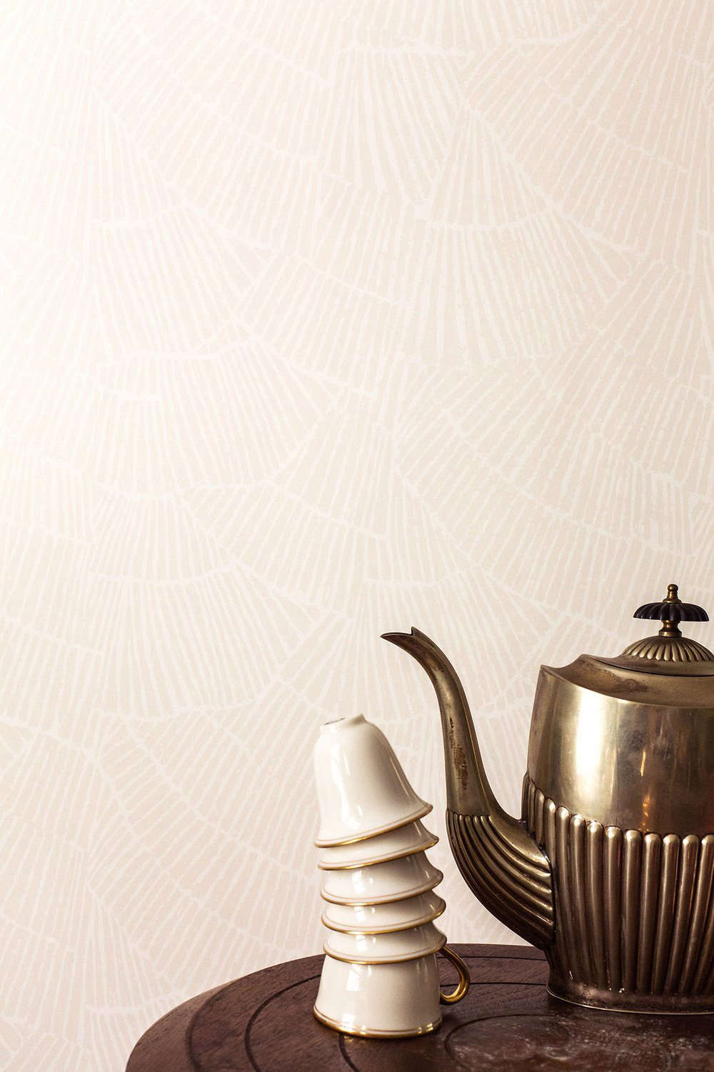 The Fayce Wallpaper Collection is available in eight patterns and  colorways (all made with earth-friendly inks), with names evocative of natural New England (Phragmites and Pines), and old-world New England (Pleat and Lapel). Shown here: the Pleat Wallpaperin Cream ($65 per yard; most are sold at a minimum of five yards). The inspiration: &#8