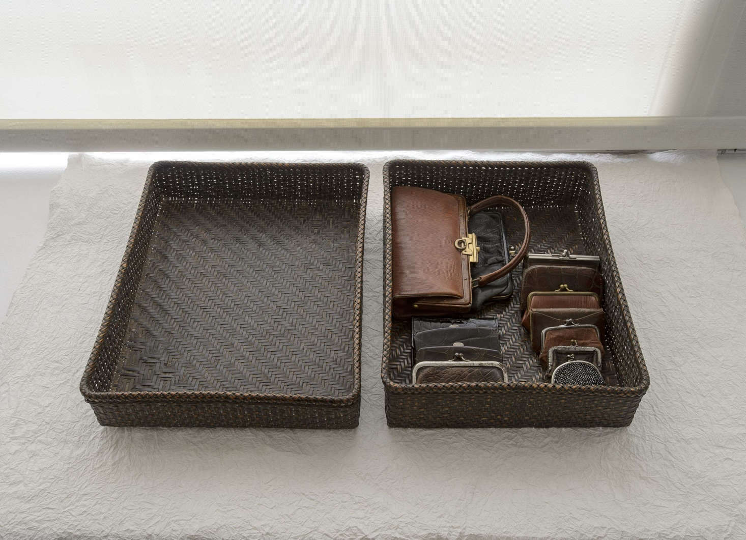 A collection of Makié's miniature vintage purchases kept in an antique wedding basket.