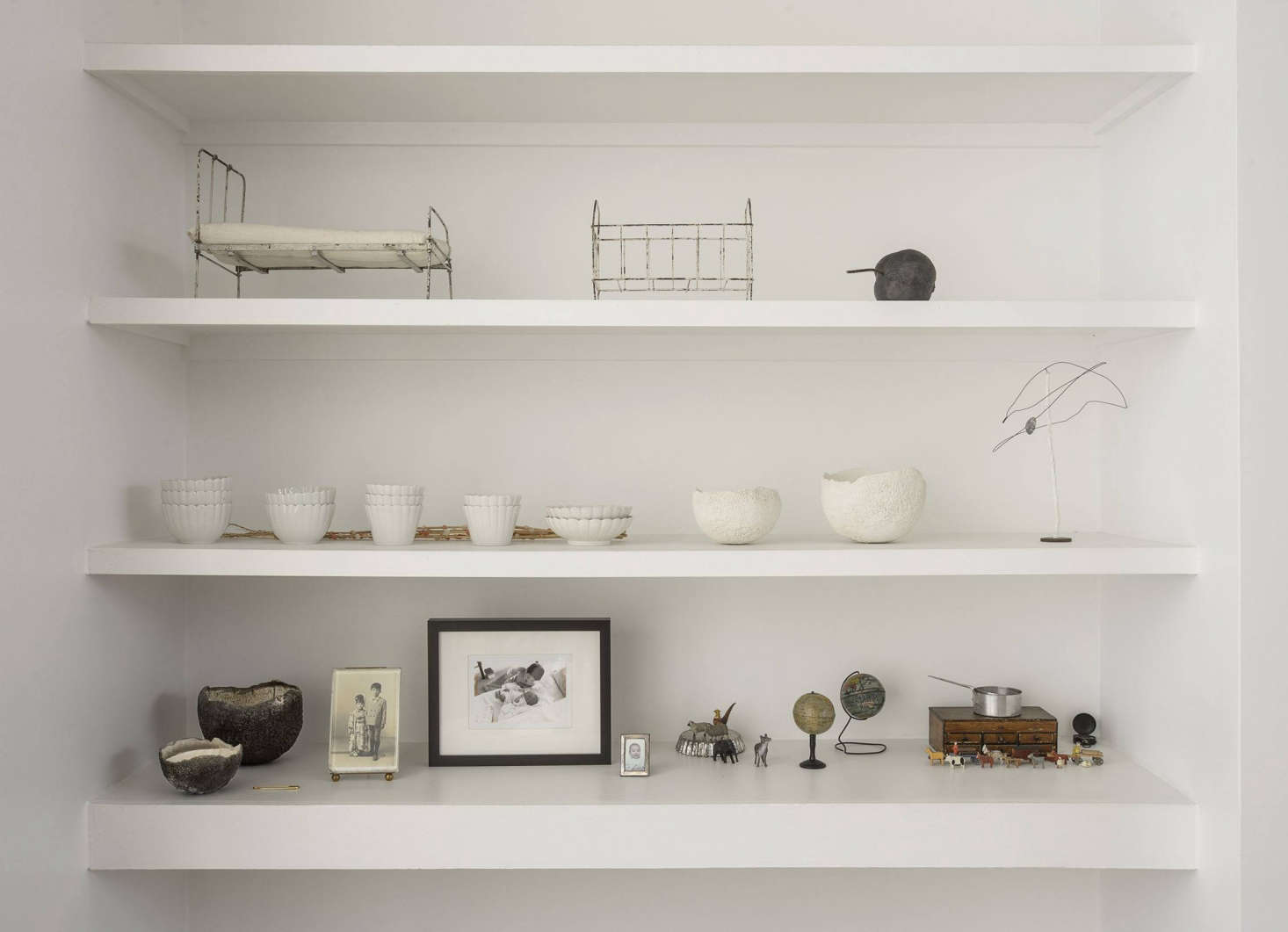 A closer look at Makié's collections; on the center shelf are 0-year-old Japanese Koimari cups and plates andGenevieve Chevallierbowls.