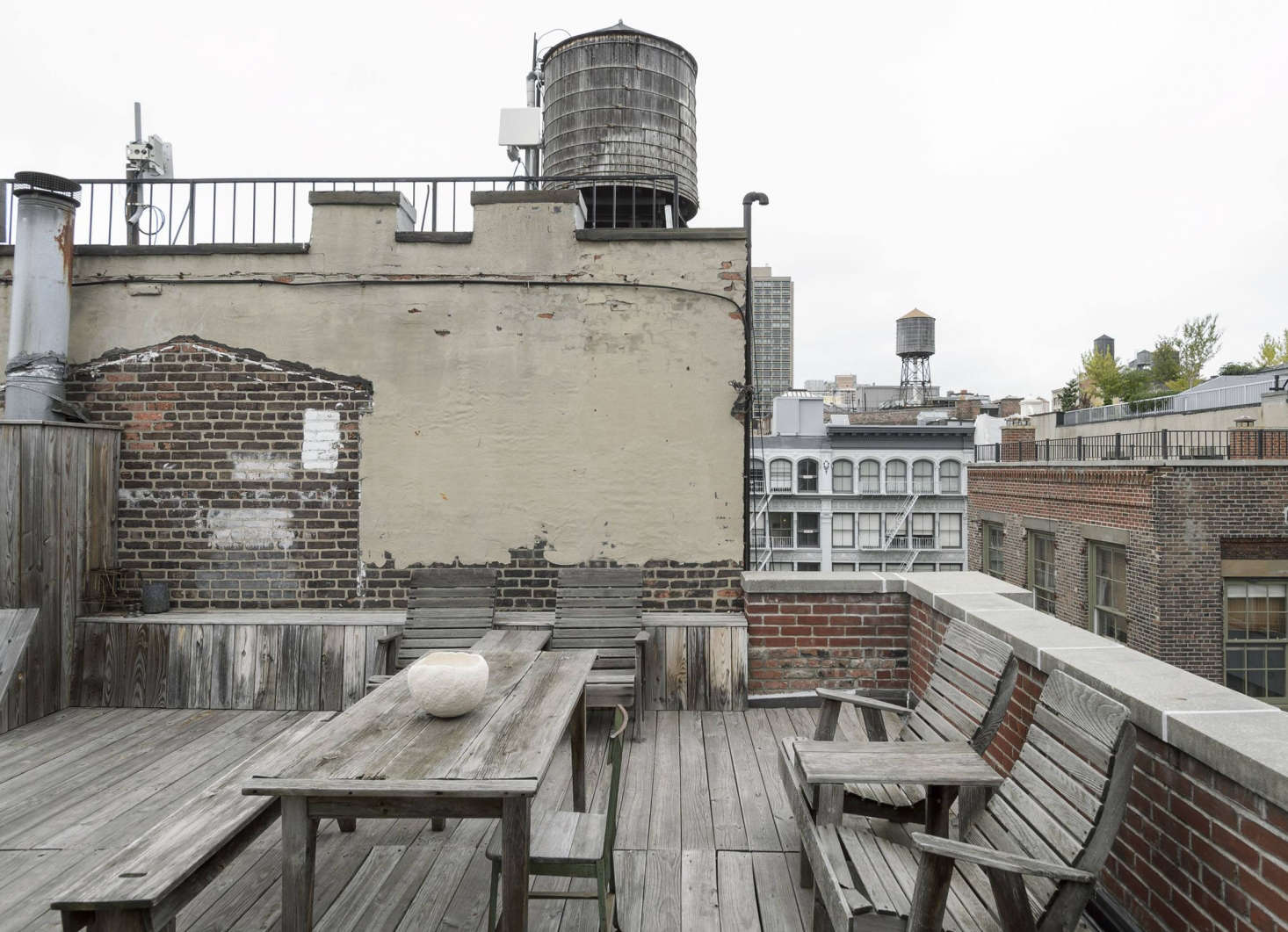 The spartan rooftop is where Makié photographs many of the products she offers on her online shop. On the table is a Genevieve Chevallier hand-shaped bowl in white.