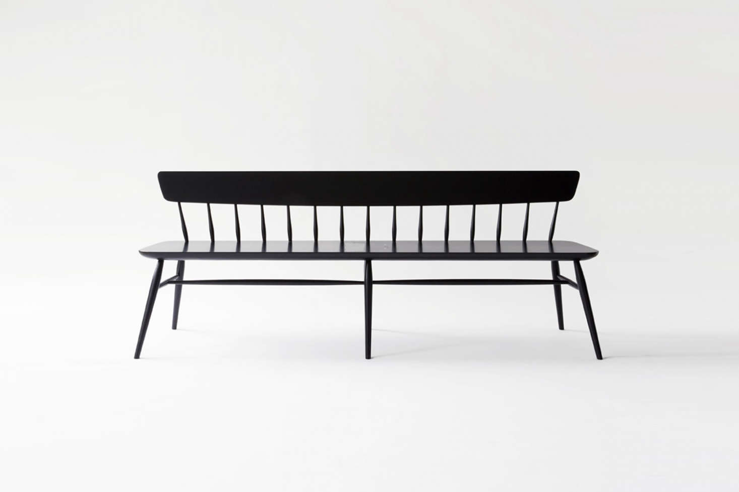The Moving Mountains Long Windsor Bench has exaggerated proportions and is finished with a matte lacquer finish. Contact Moving Mountains for price and ordering information.