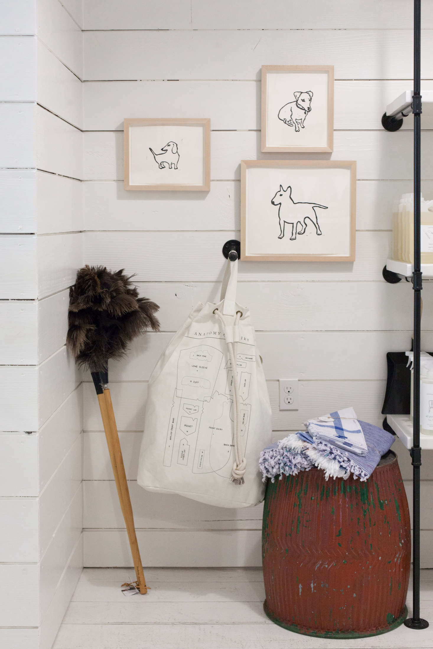 In the cleaning section: an Izola laundry bag and three Hugo Guinness dog prints.
