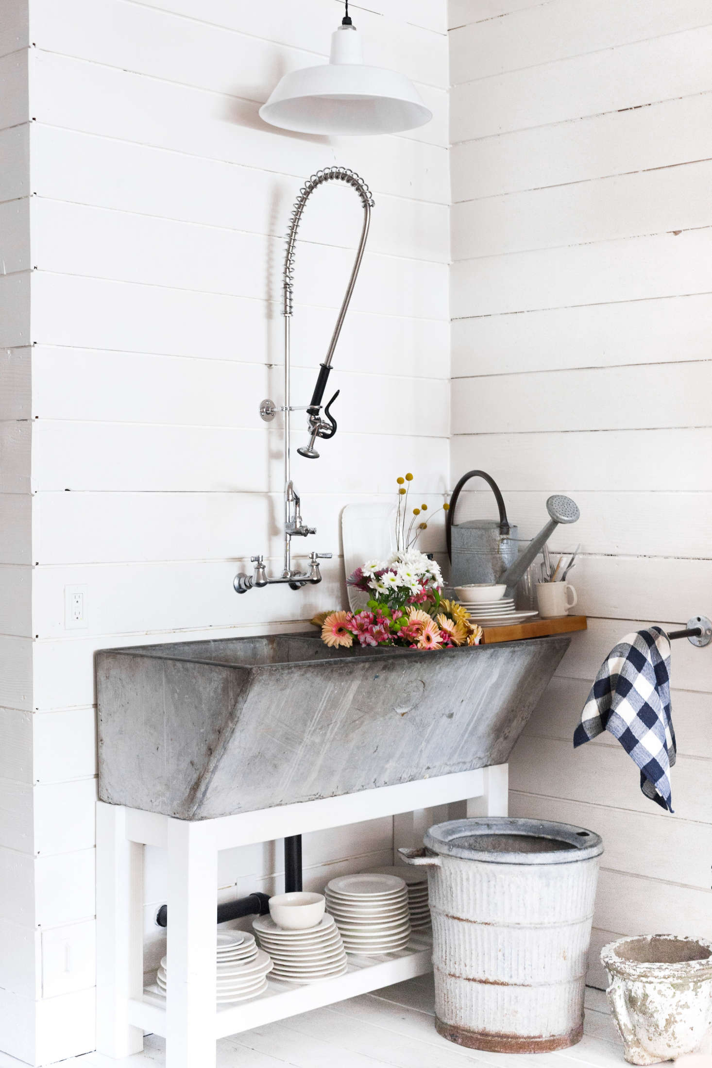 A vintage farmhouse sink at the back of the store is used for watering flowers and rinsing the occasional dish.