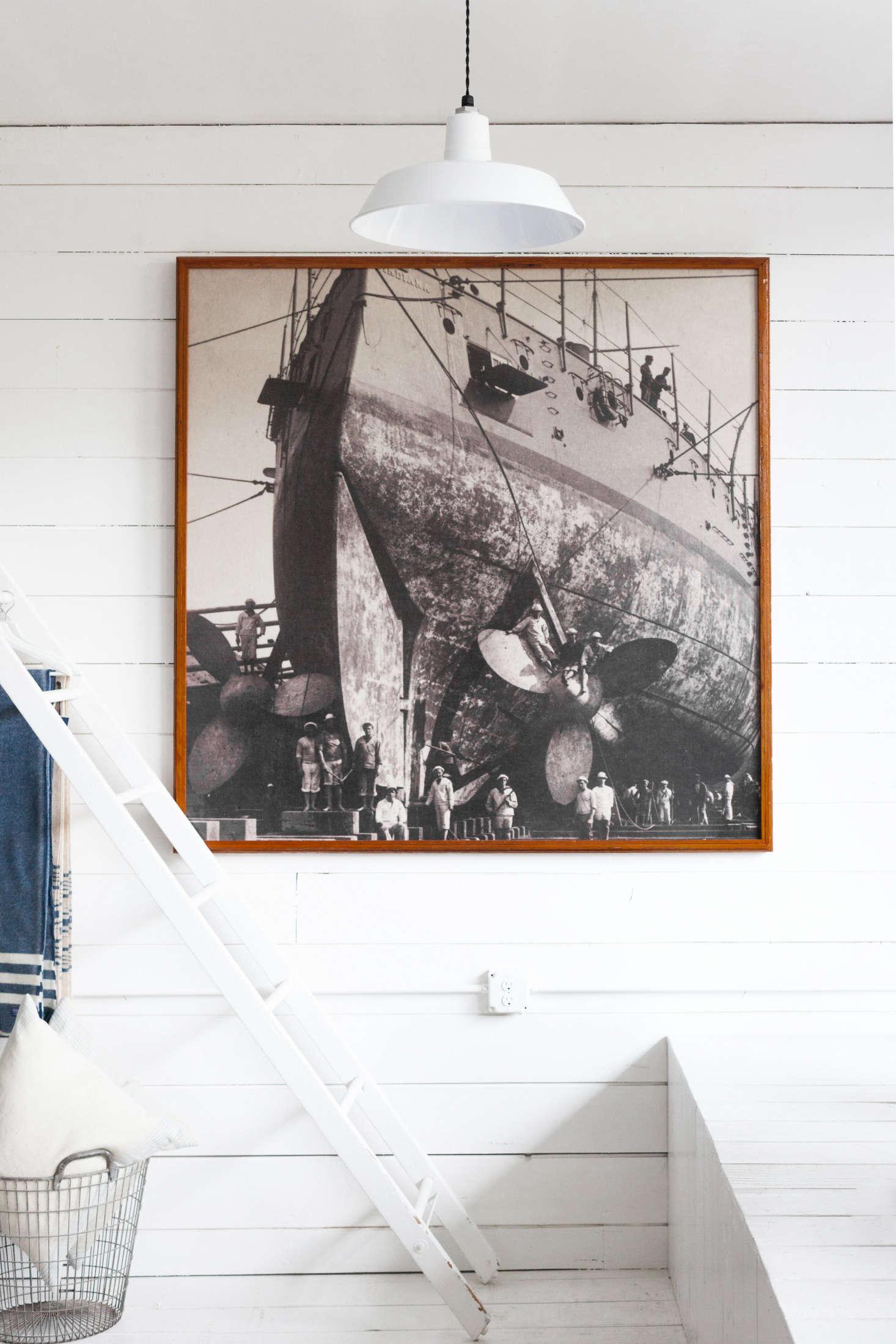 An antique photo of a shipbuilding scene sets the subtle nautical theme of the shop.