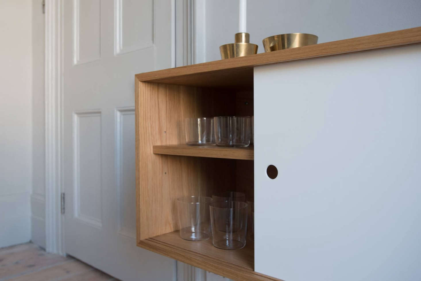 The sideboard is an extension of the kitchen and stores breakfast cereals plus everyday plates and glasses.