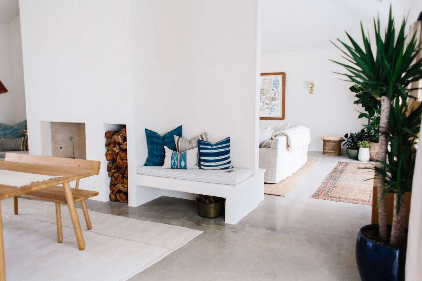 Everywhere except the bedrooms, flooring is unstained gray concrete. Towill used a mix of linen and mud cloth throw pillows throughout the house, mostly from House of Cindy.