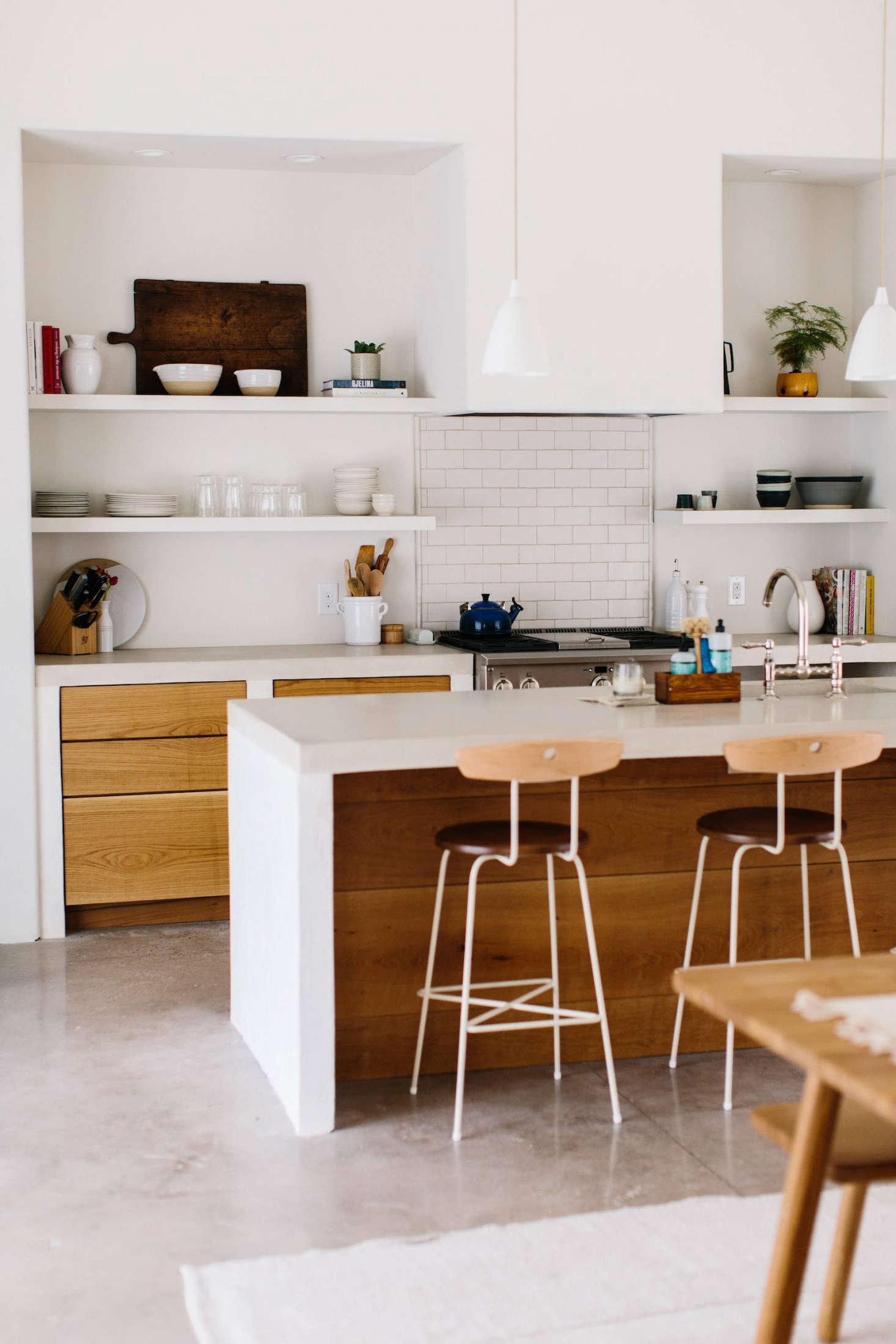 The Kitchen Island Is Poured Concrete On Plaster Legs With Oak Slab Cabinet  Fronts.