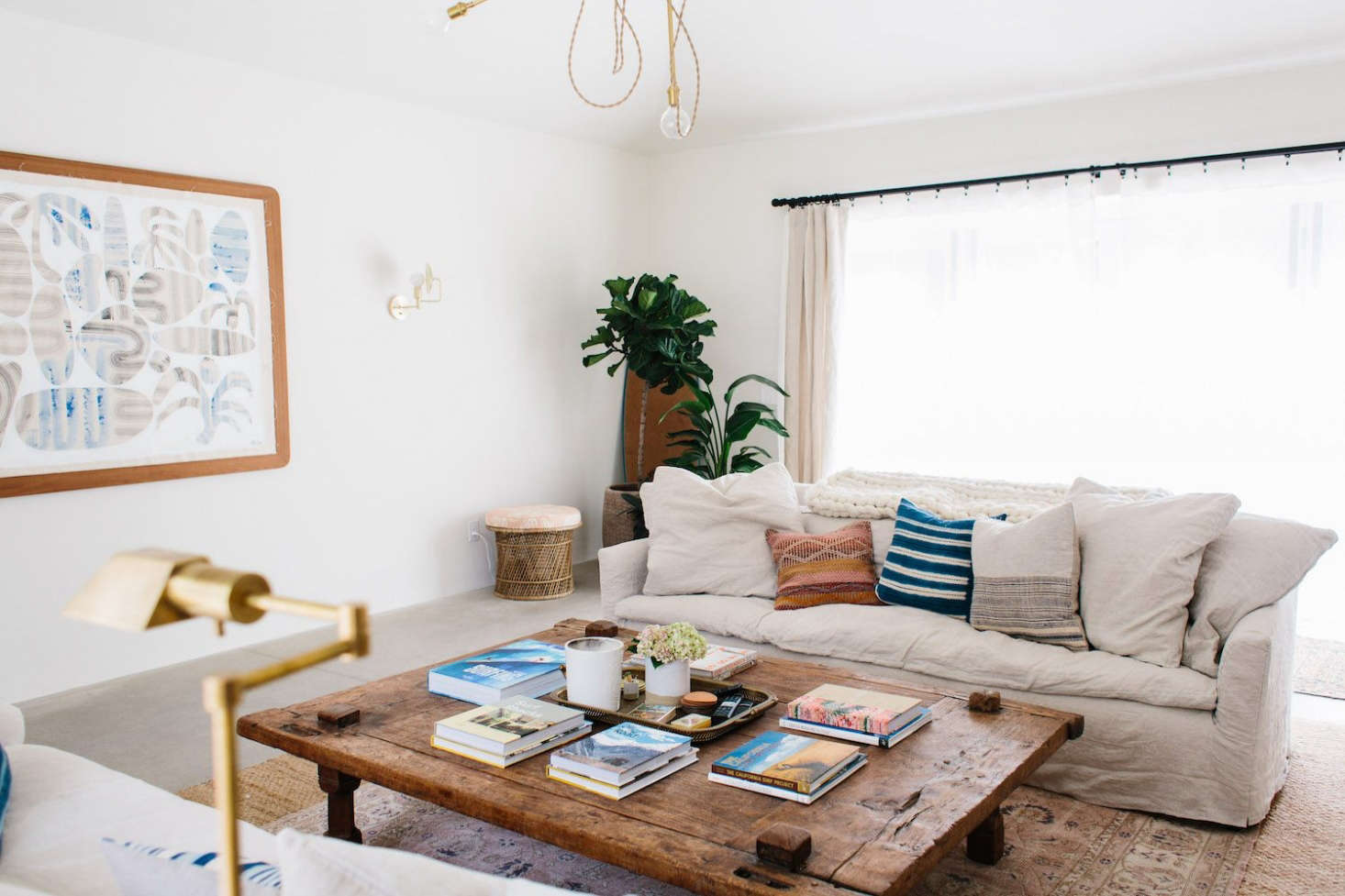 """The project's biggest splurge was on a Belgian coffee table the designer found on 1stdibs. """"It's massive,"""" she says. """"I think three people could sleep on it."""" The artwork is by Ty Williams."""