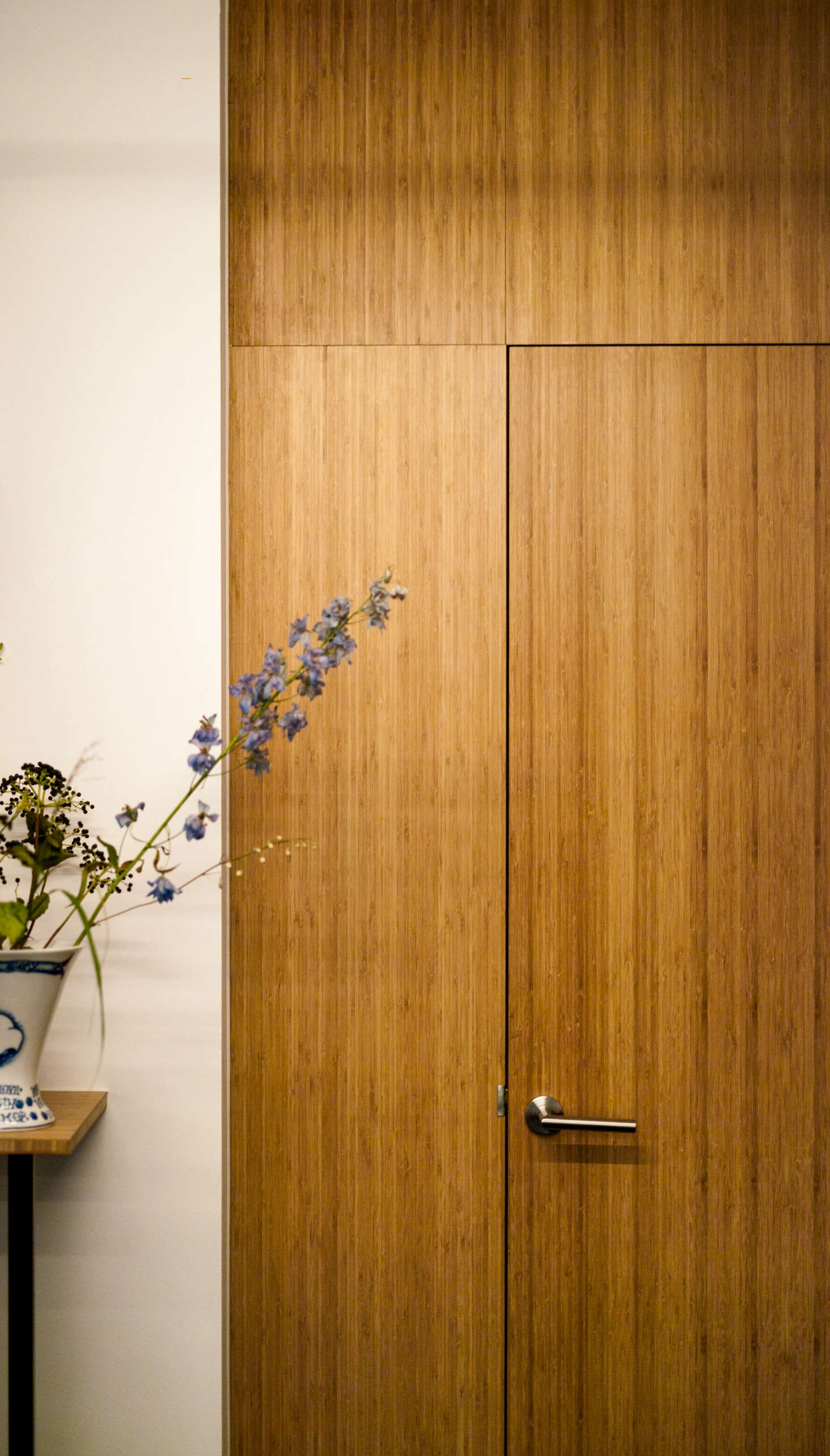 "A wooden door leads to the WC. ""I always have tons of plans,"" says Flink, ""Collecting ideas is my process."""