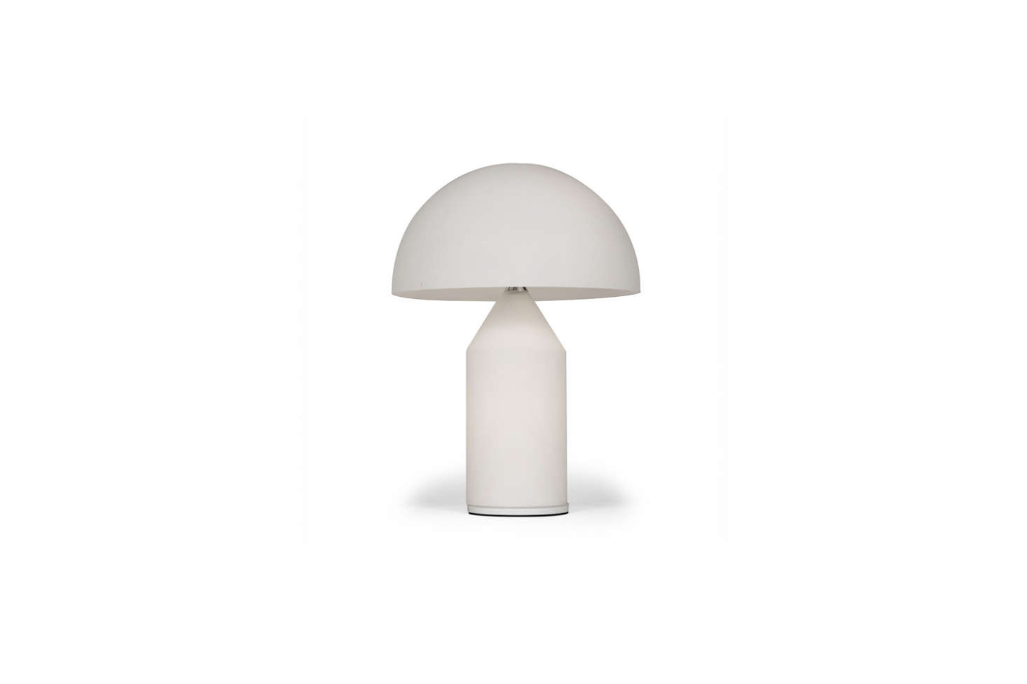 On the desk: The Atollo Table Lamp, by Vico Magistretti for Oluce, has a domed Murano glass diffuser. DWR sells it in two sizes (small and medium); from $990.