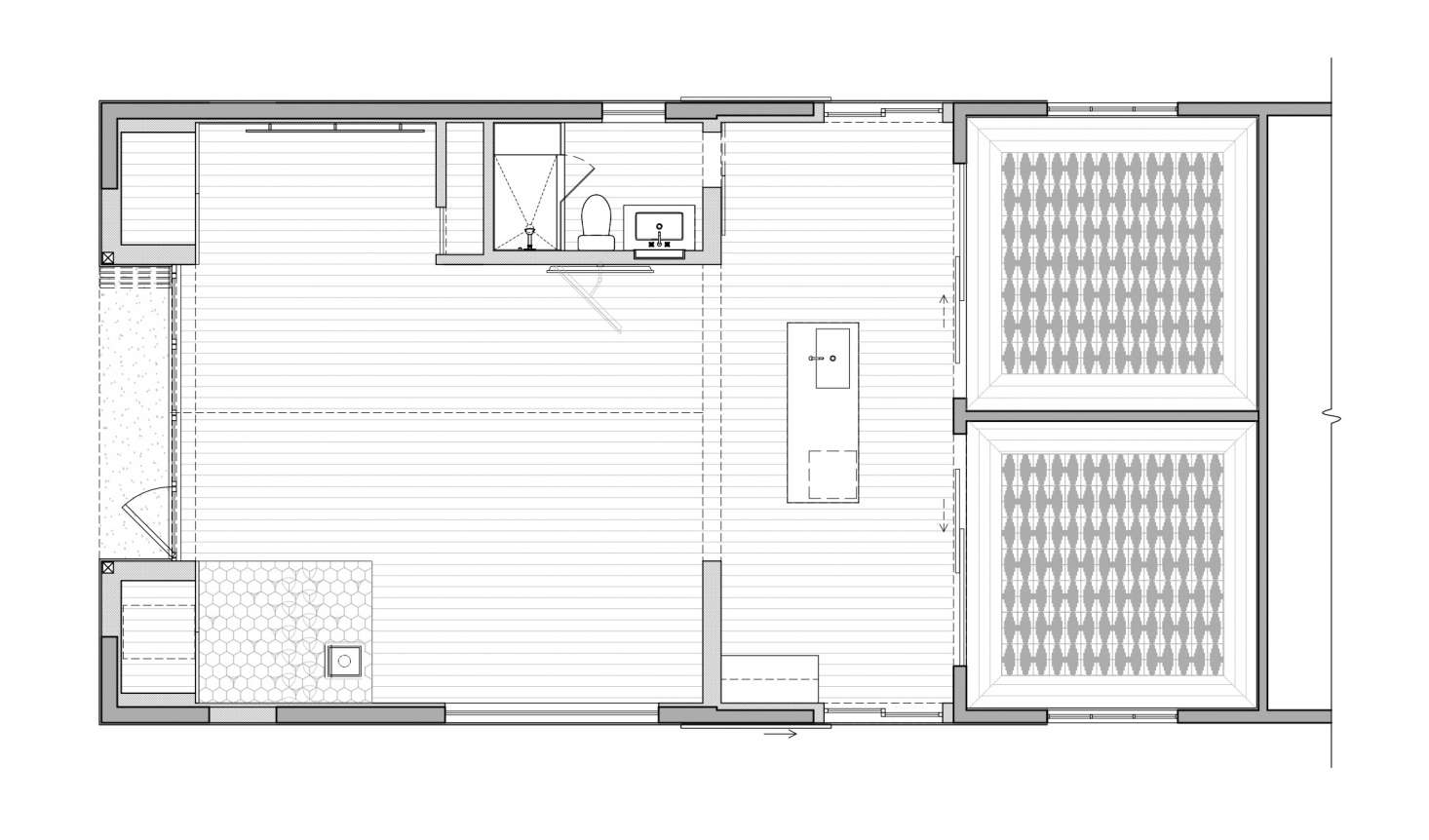 The guesthouse has two bedrooms, a kitchenette, bathroom, and lounge space totaling around 1,125 square feet.