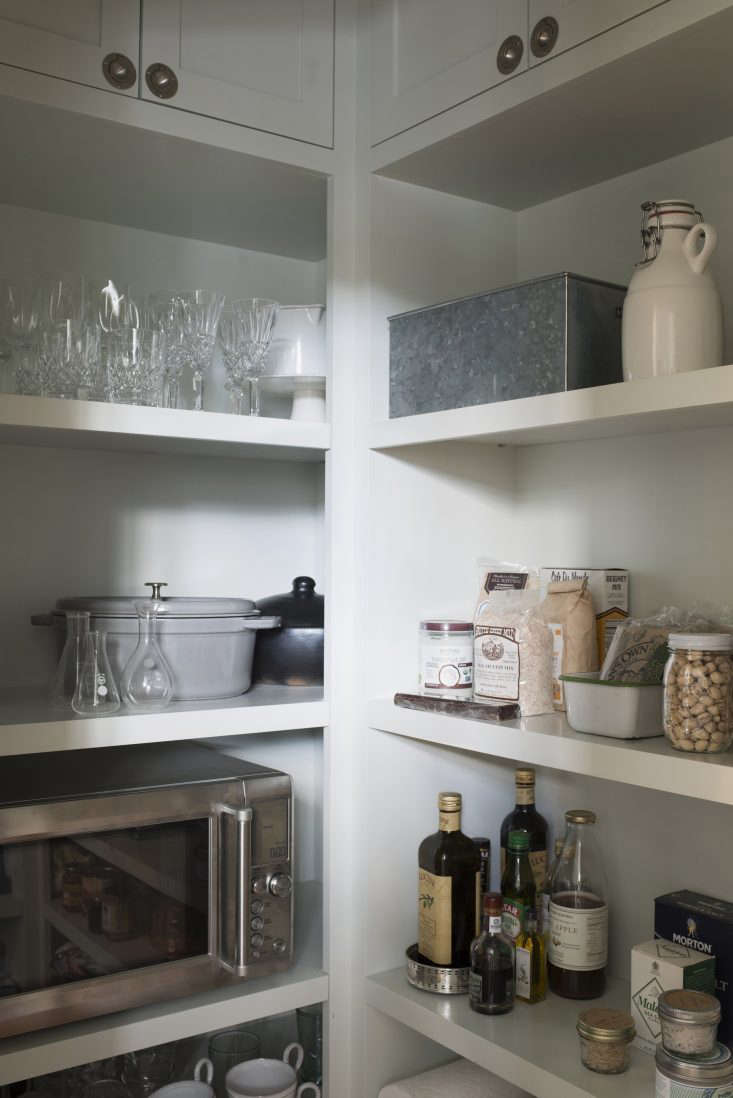 """Says Clare McCamy of her Mill Valley, California, kitchen, """"I love our walk-in pantry. Our designer did a near-perfect job of hearing us out about what we have and what we wanted and giving us just slightly more storage than we need."""" See more in Kitchen of the Week: A New-Build Kitchen in Mill Valley, CA, the Six-Month Check-Up. Photograph by Andres Gonzalez for Remodelista."""