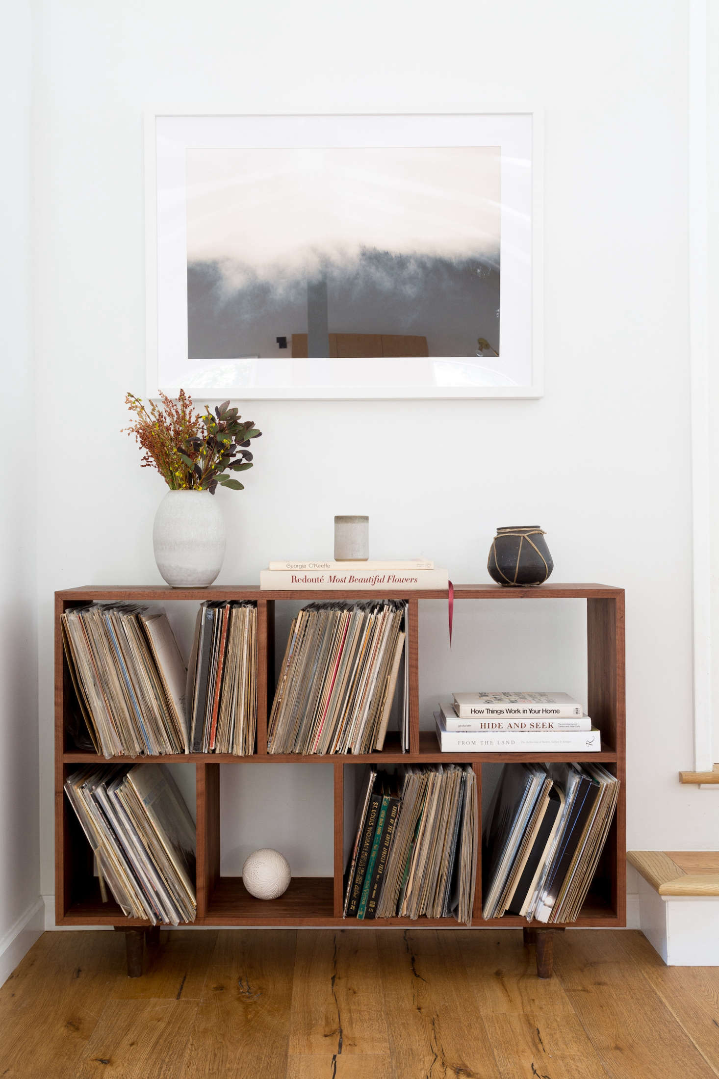 Hunter and her husband have an admirable vinyl collection. The artwork hanging above the bookcase is by photographer Brian Merriam, sourced from online art dealerTappan.