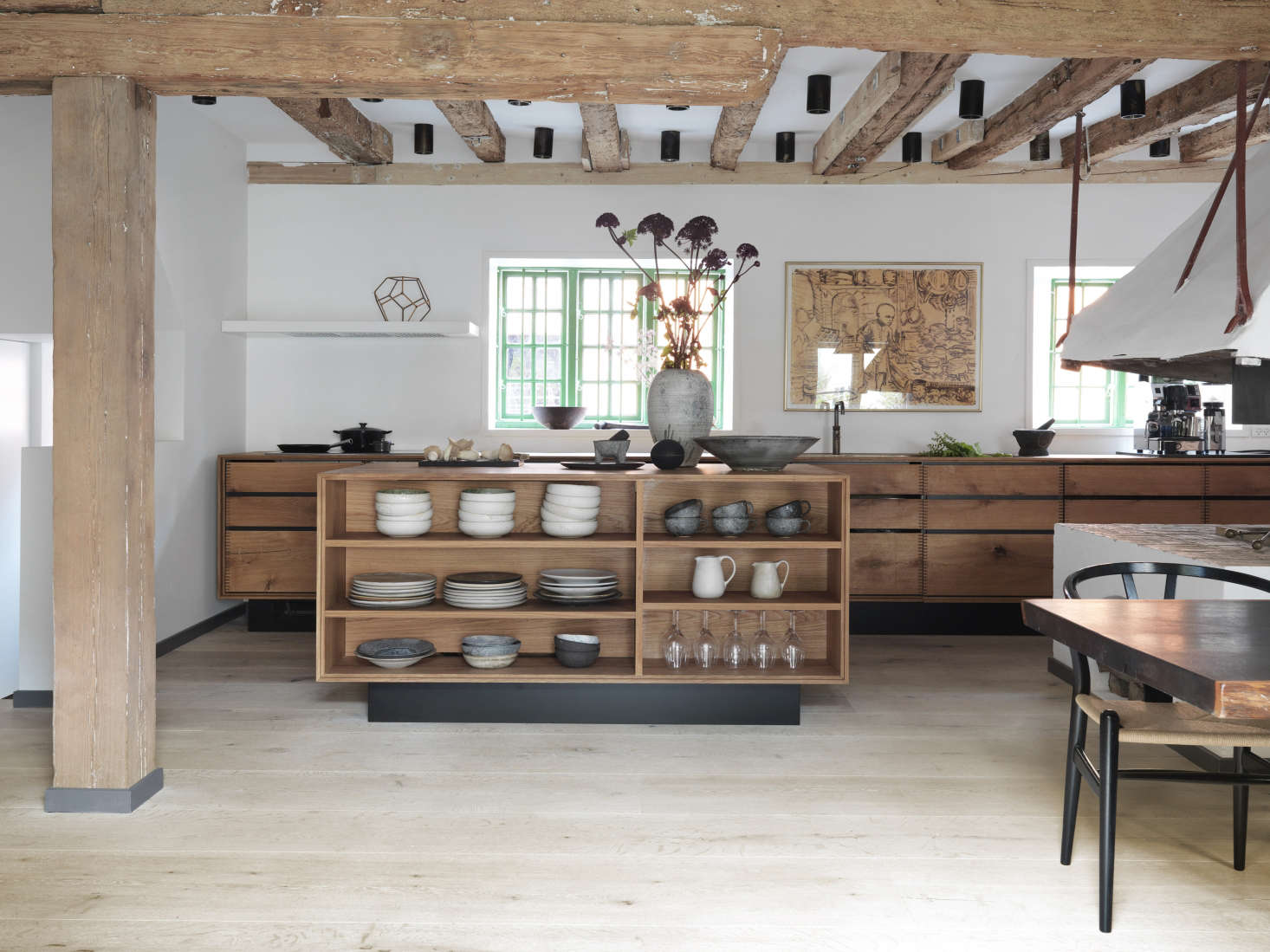 Open shelving on one side of the kitchen island keeps ceramics from Noma on display.