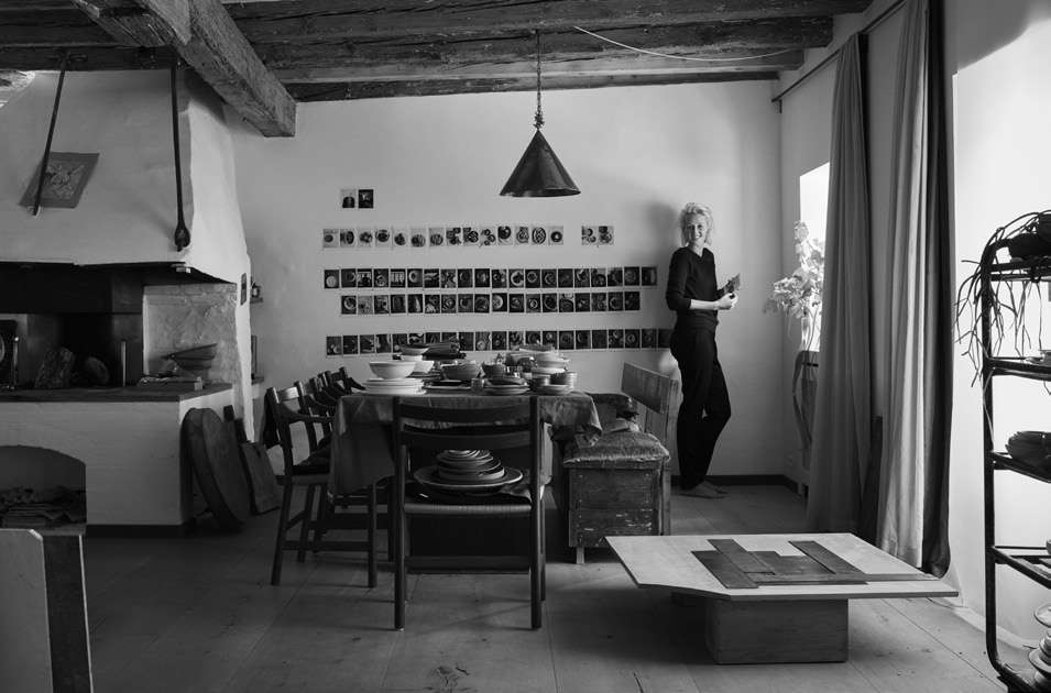 The dining table, with eclectic seating. Photograph by Ditte Isager.