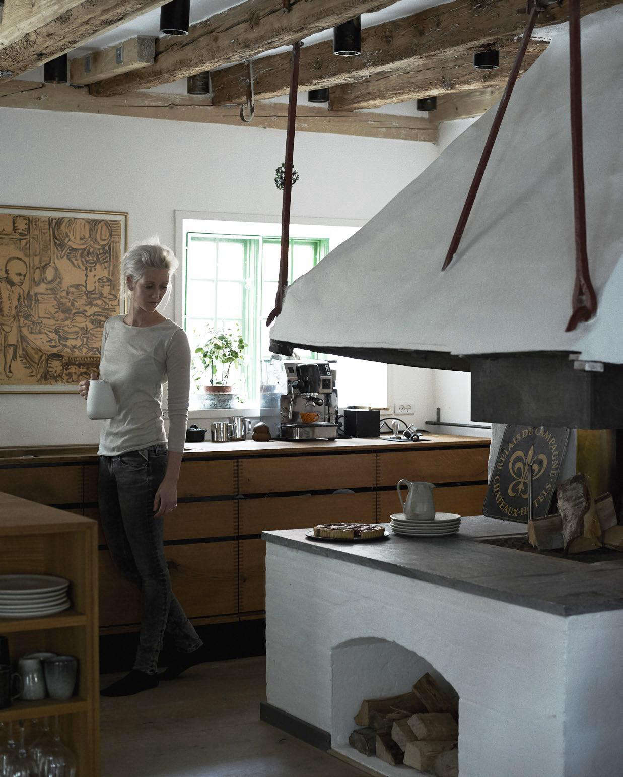 Nadine by the woodstove. Photograph by Ditte Isager.