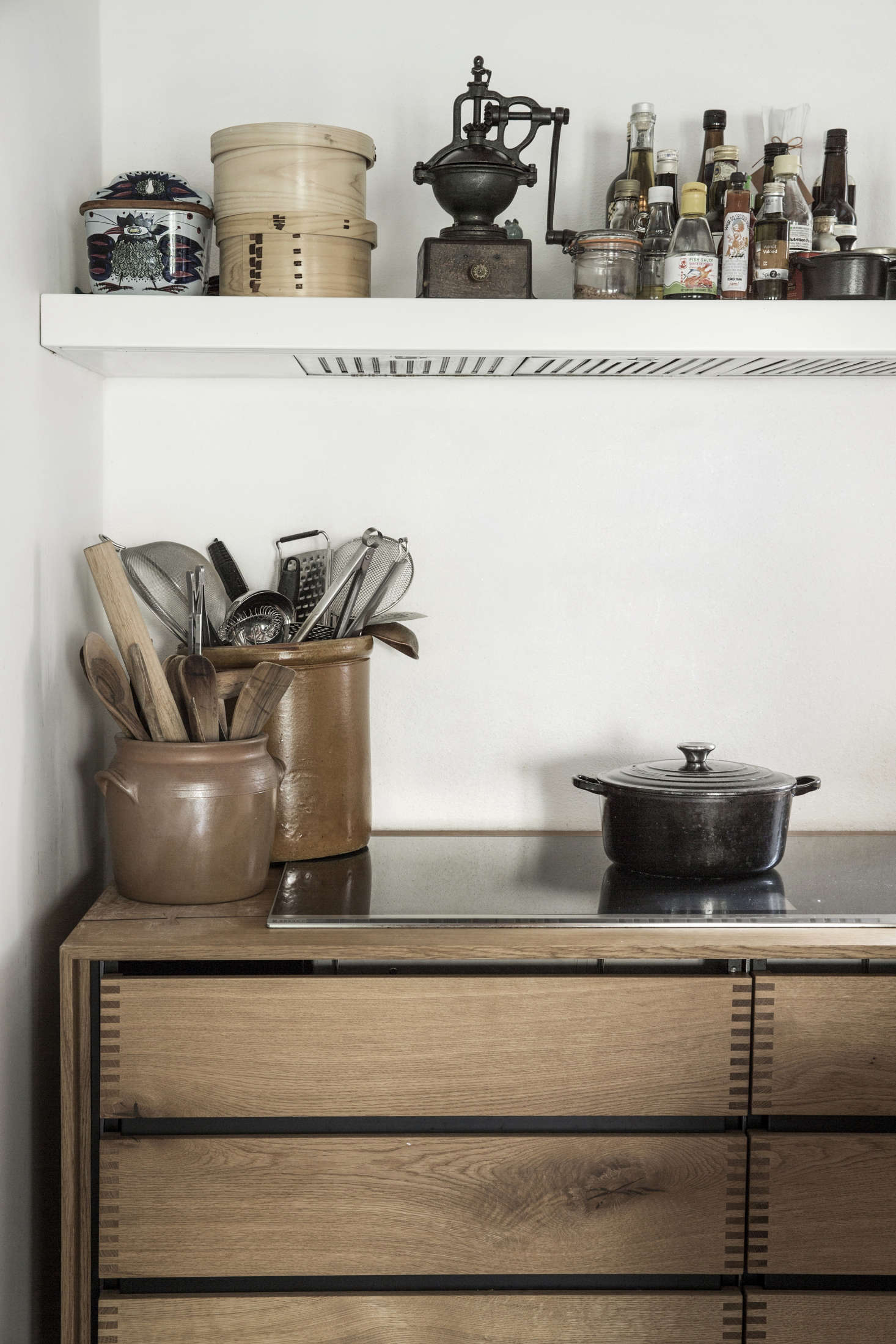 Large ceramic pots hold much-reached-for kitchen tools. Photograph courtesy ofDinesen.