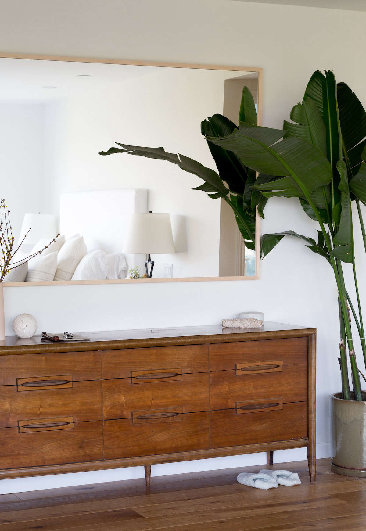 The vintage credenza, used as a dresser, is from Chairish.