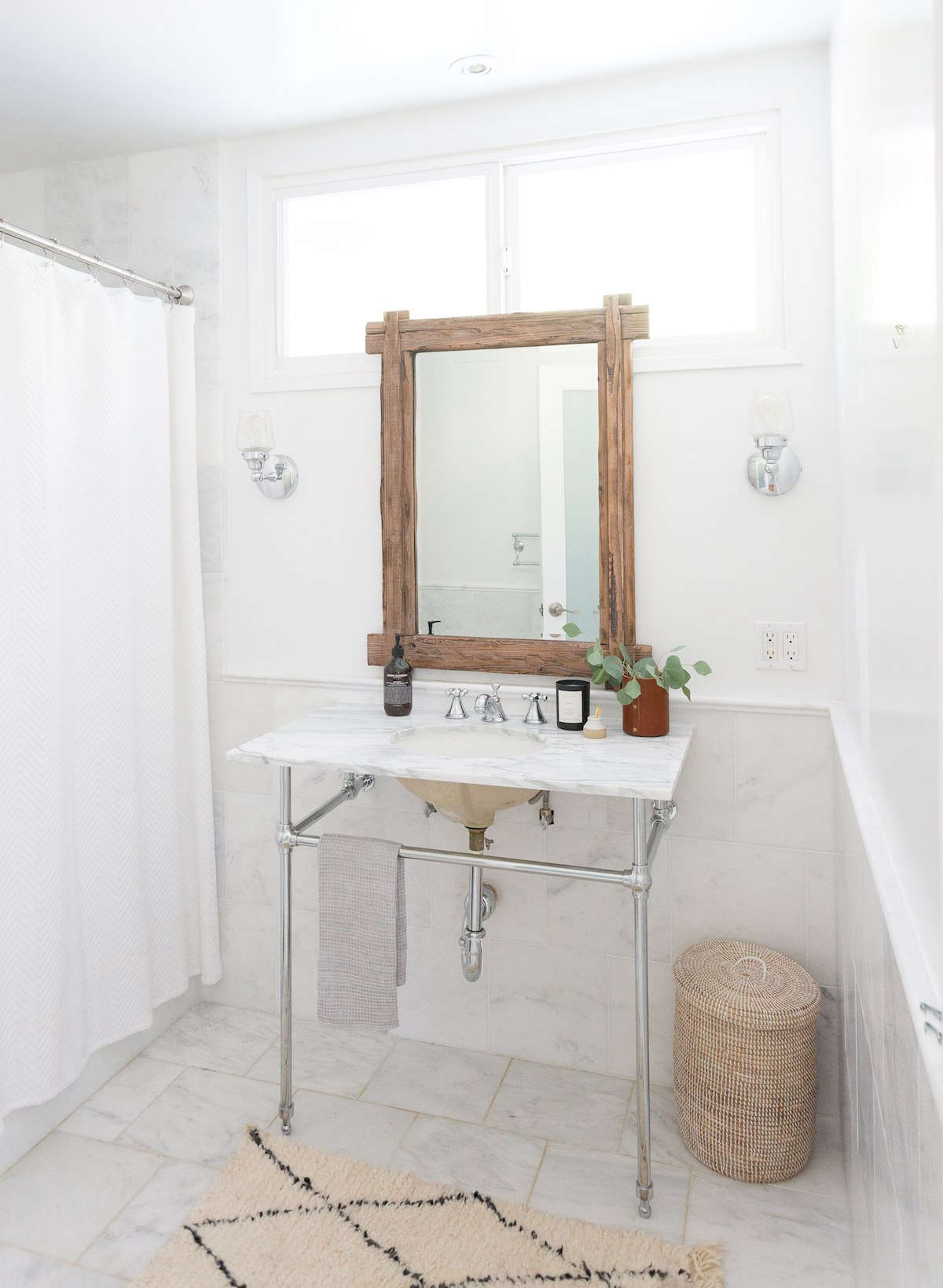 """Hunter used Remodelista as a guide when remodeling her bathrooms, including the upstairs powder room shown here. Our White Bathroom Roundup, she said, """"showed us how much flexibility there was to work with using an all-white palette."""""""