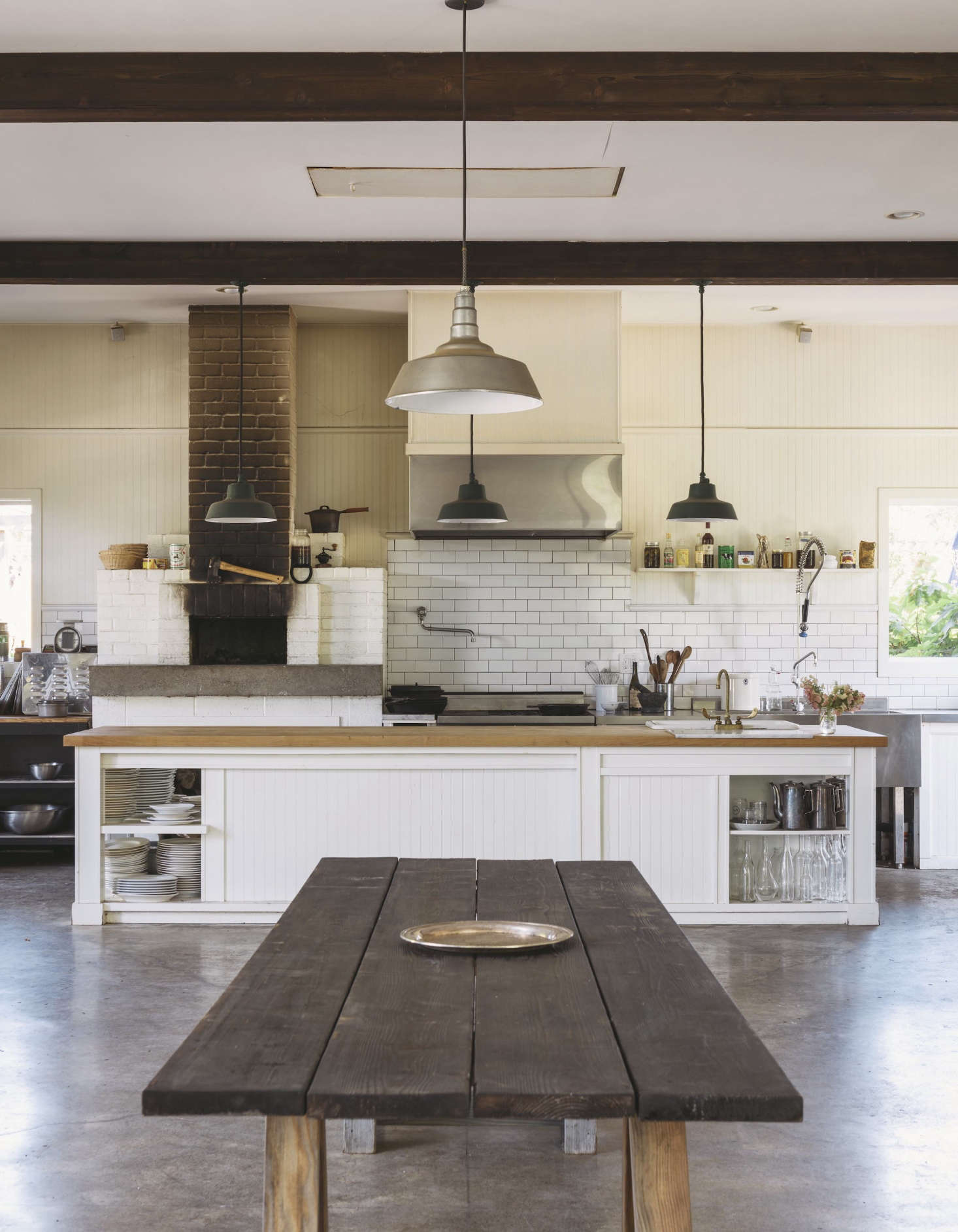 Practicality Reigns In The Kitchen, With A Woodstove, A Subway Tile  Backsplash, And