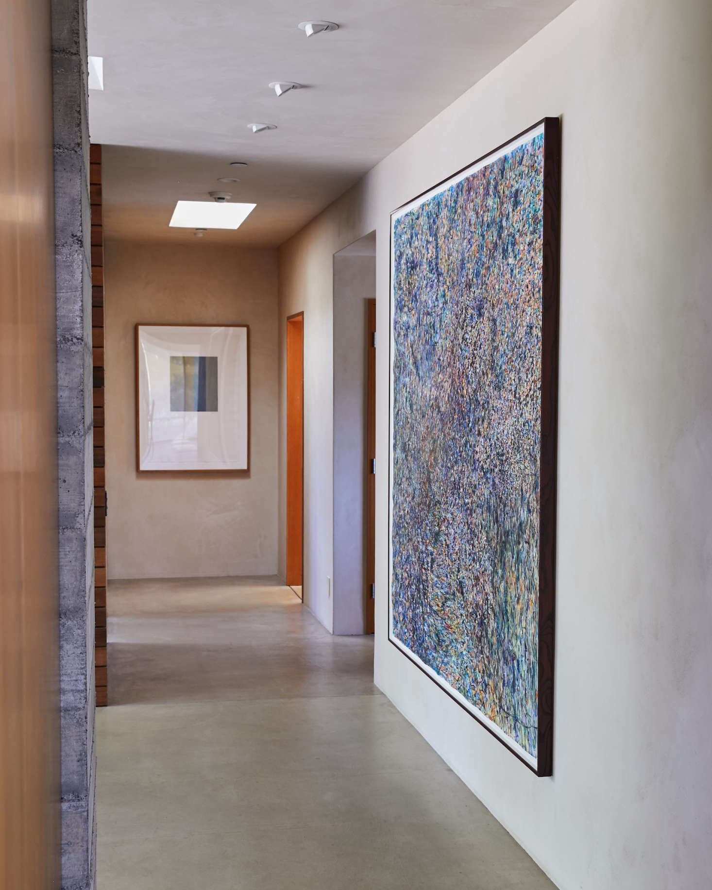 A dramatic painting in the foyer anchors the entrance. It&#8
