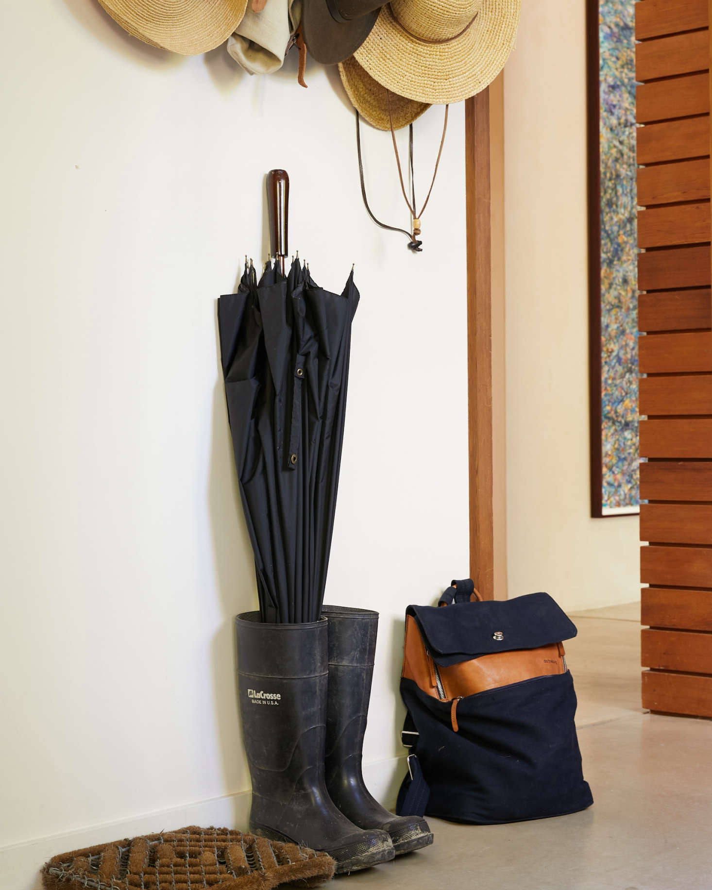Inside the paneled volume is a mudroom to store coats, boots, and hats. Singer&#8