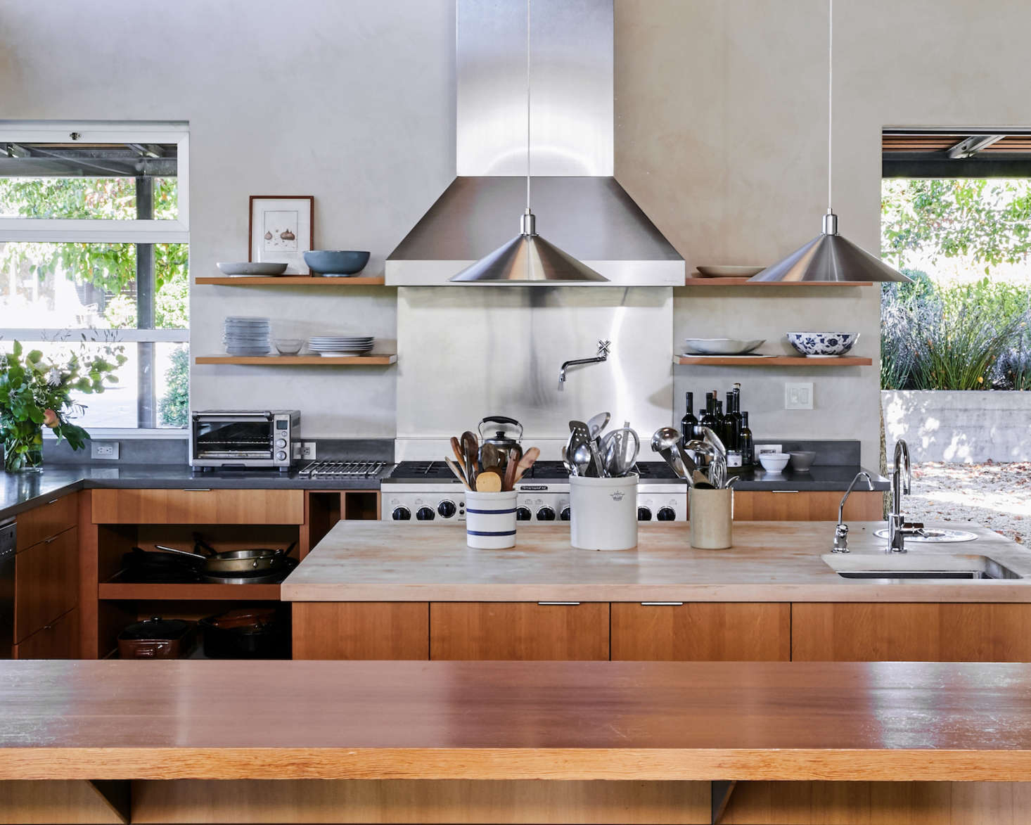 The Large Central Island Has A Butcher Block Countertop, Integrated Sink  And Compost Pail,