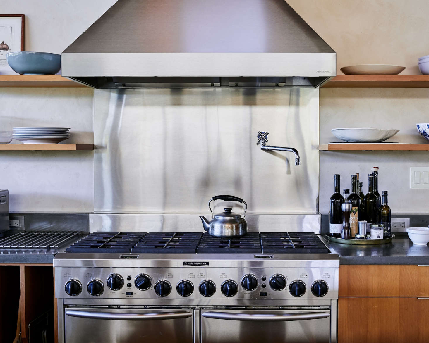 The Backsplash Of The Oversize Gas Range Is Stainless Steel, As Are All The  Appliances