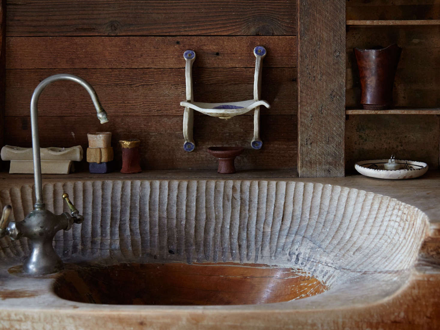 Blunk's hand-hewn bathroom sink, with marks from his chisel.