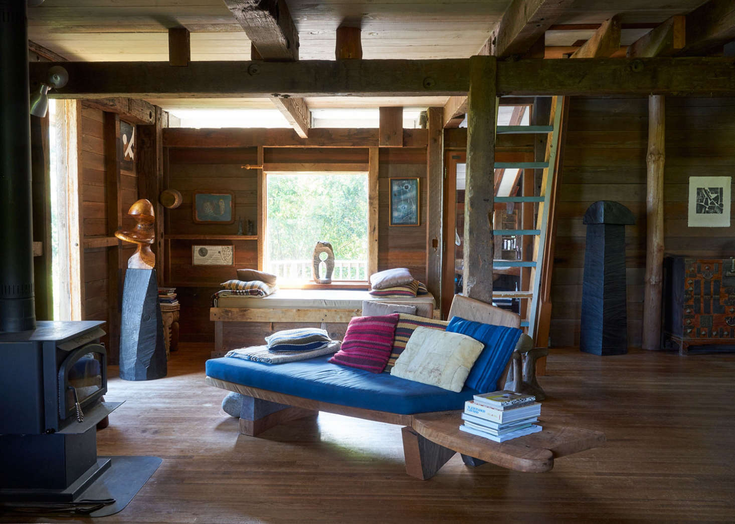 The open-plan living space, with a carved, benchlike couch.