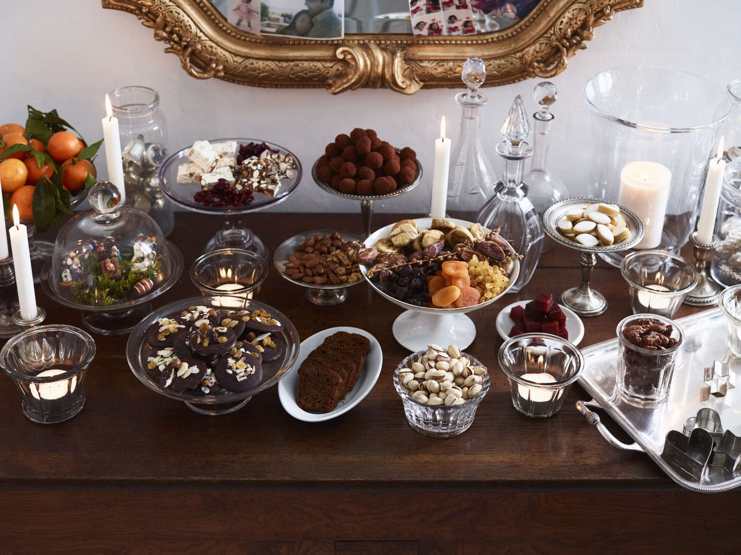 Do as the French do and let sumptuous bowls of food double as decor. Here—following the Provençal tradition of Thirteen Desserts—nuts, dried fruit, and sweets look elegant when displayed in mix-and-match cut glass and silver heirlooms. Photograph by Anson Smart fromChristmas in Burgundy: At Home with the Expat Family Behind the Cook's Atelier.