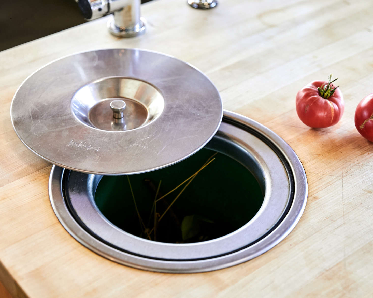 """This being Northern California, """"Most of my clients want some type of composting function designed into the kitchen,"""" said Anding. This stainless steel version is fully integrated into the butcher block countertop."""
