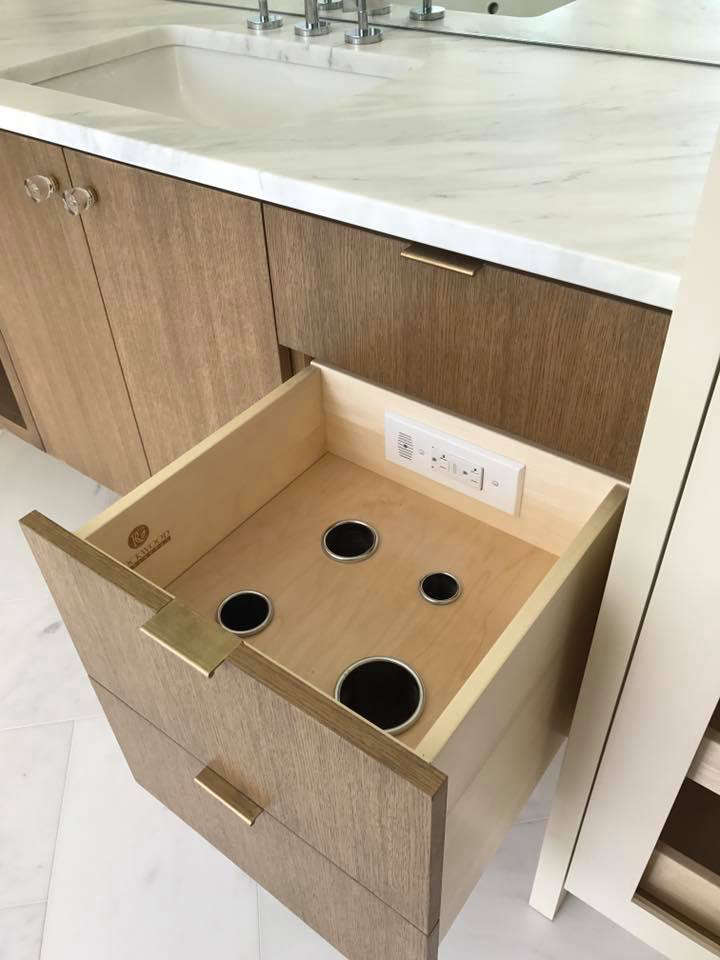 A Docking Drawer Powering Outlet installed in a bathroom drawer. Photograph by Rockwood Cabinetry.