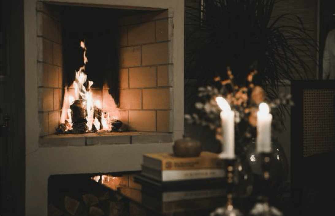 """""""We spent hours in the 'living room' by the fire,"""" Francesca says; the small fireplace is tiled, with wood stacked beneath."""