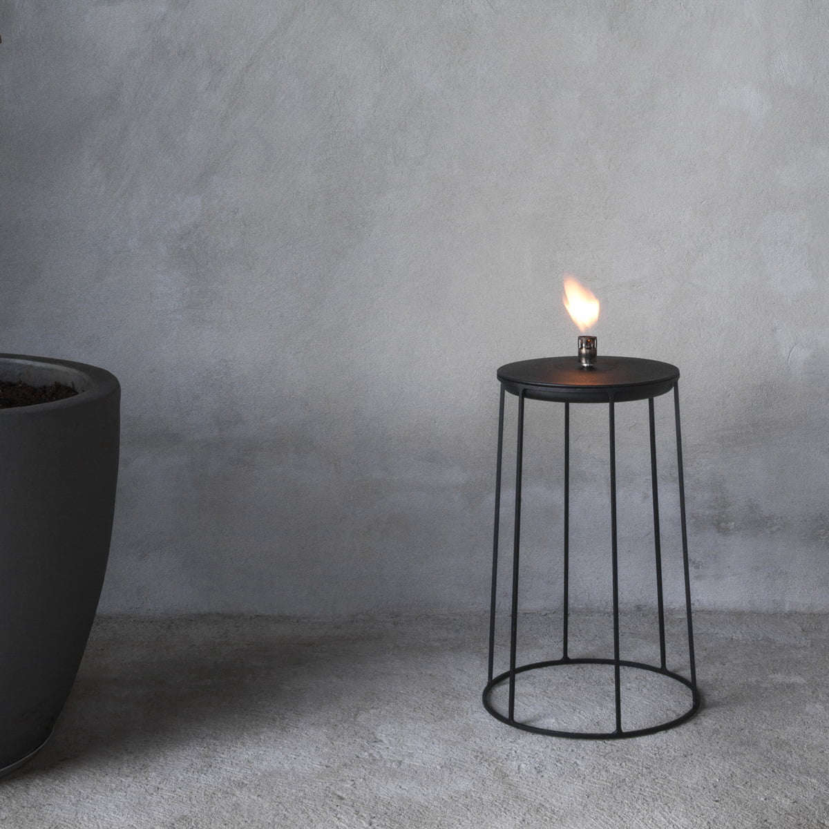 Inspired by a visit to a Japanese garden in LA, the powder-coated steel Wire Disc Oil Lamp by Norm Architects is $89.90 from YLiving.