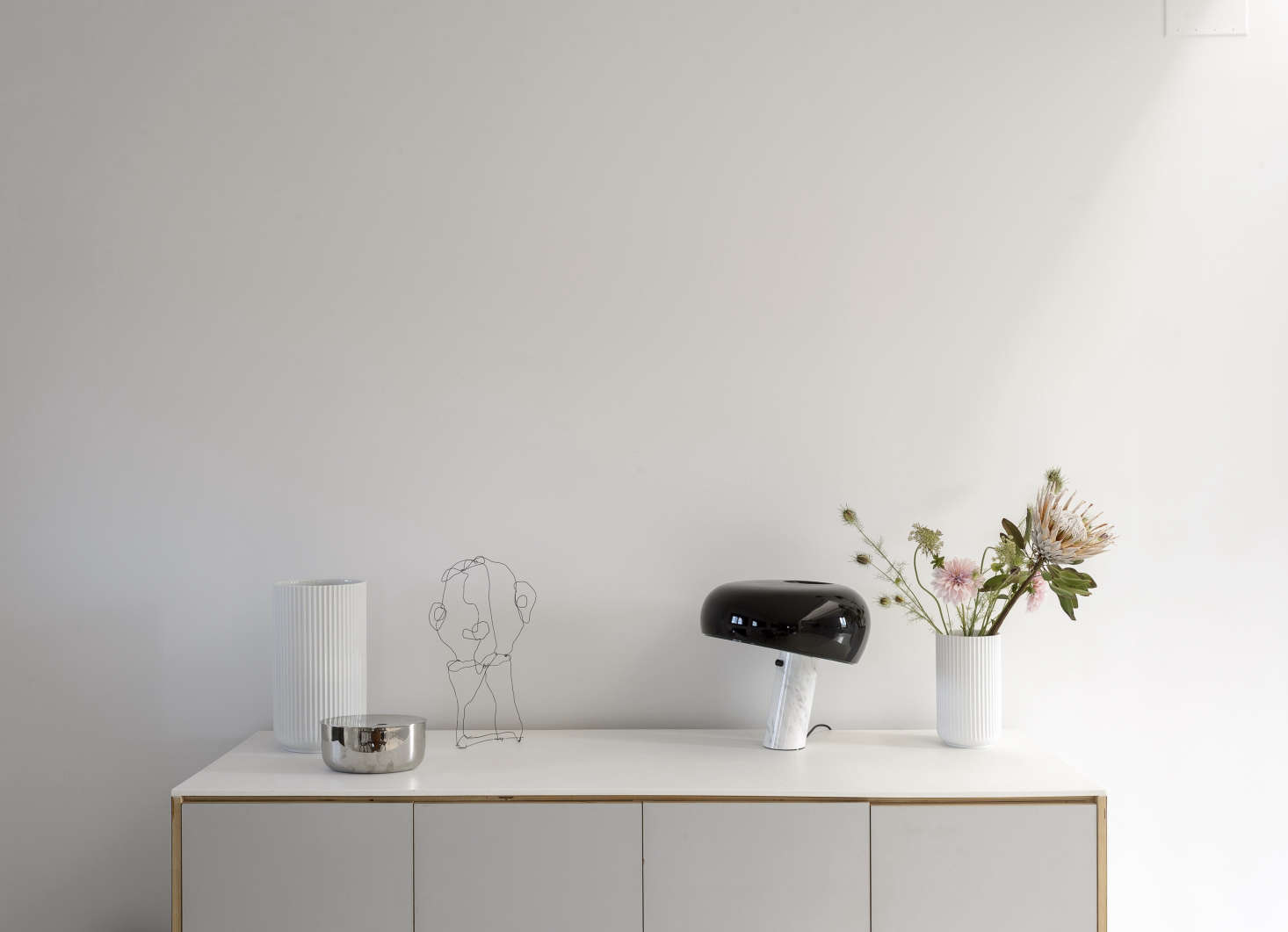 The sideboard, like the kitchen cabinets, is an Ikea hack. It displays flutedLyngby Vases by Danish porcelain company Lyngby. The wire sculpture is a portrait of Peder by Camilla's sister, Pernille Vest (@pernille.vest), who is a kindred spirit: She's an interiors stylist in Copenhagen and a regular contributor to Danish design magazine Rum.
