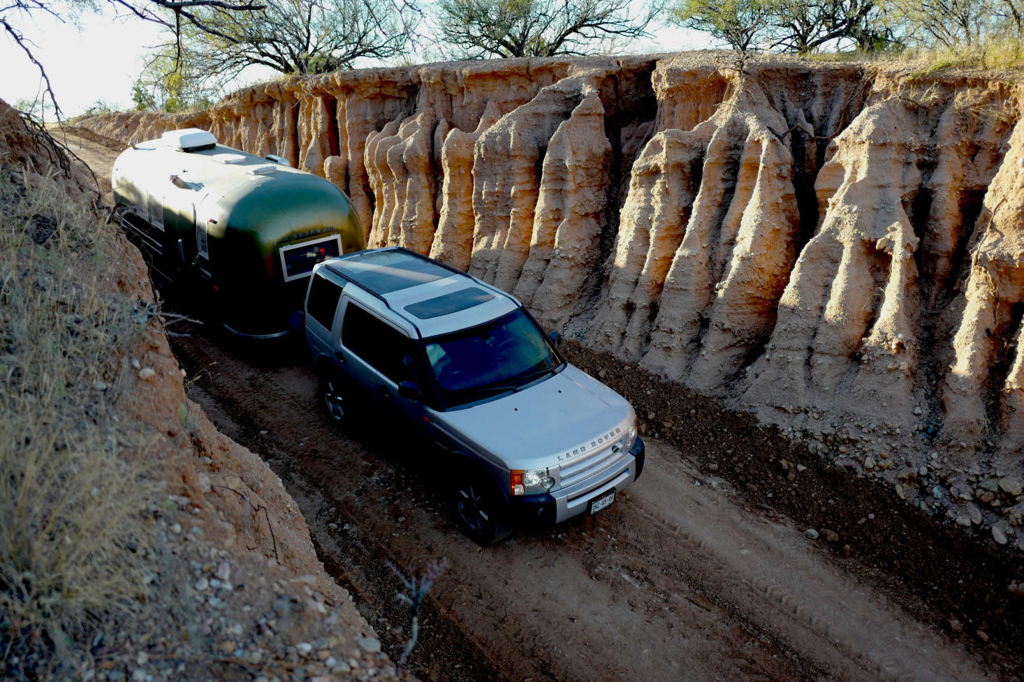 A dramatic eroded gully leads to the Casamidy ranch. The family drives a Land Rover Discovery 3 V-8 that provides crucial extra storage space for on-the-road living.