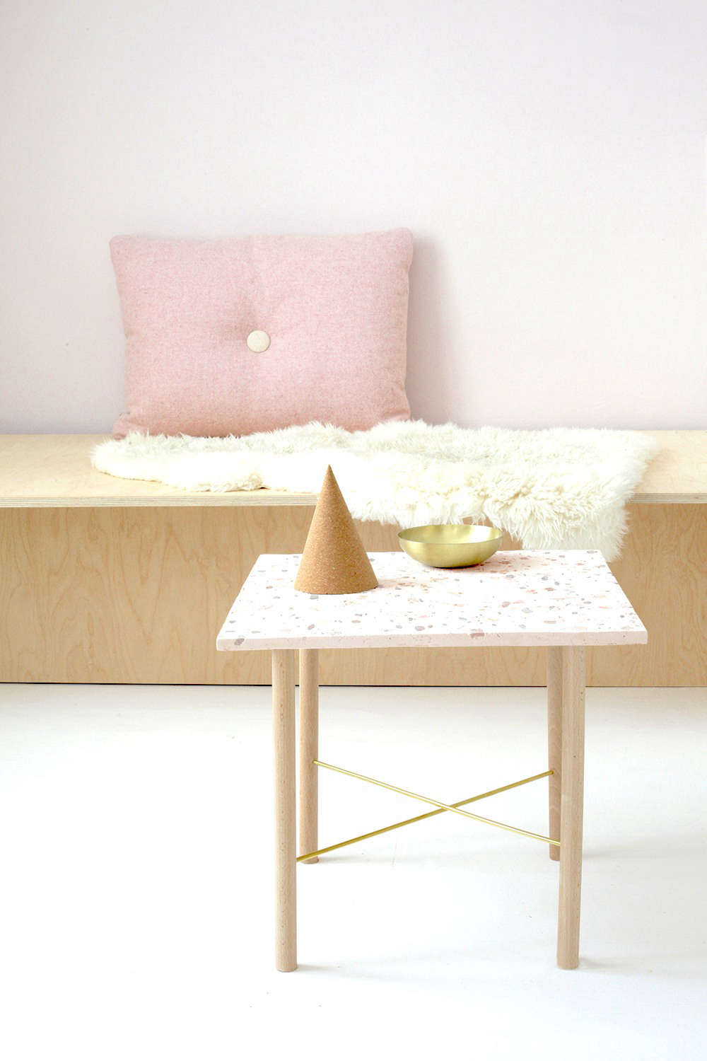 Perfect for use as a coffee table or side table, the design is entirely DIY, including the wood-and-brass base.