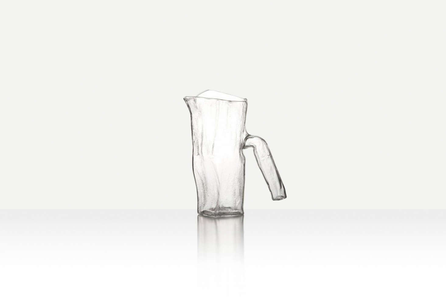The Pressed Textural Jug from Jochen Holtz is free blown from borosilicate and has a textural pressed interior; it's available from the New Craftsman. For something similar, consider the HAY Glass Jug from MoMA Store.