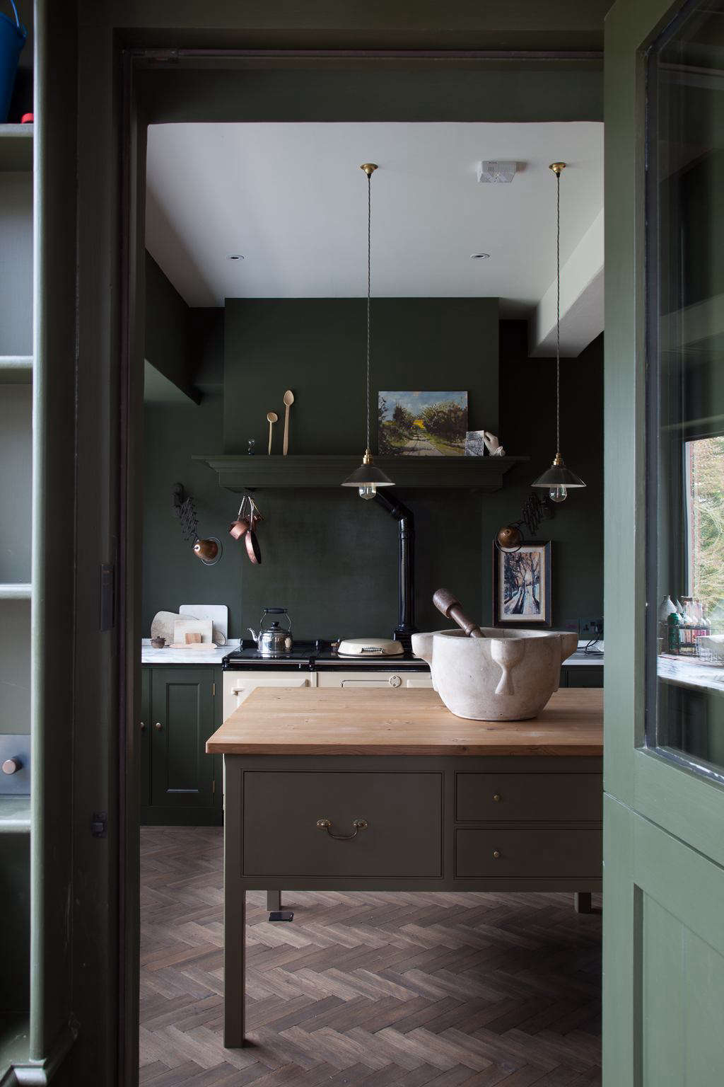 Tucked inside a circa 1890 farmhouse in Shropshire, England, this Plain English kitchen has walls, cabinetry, and doors painted in the same color: the brand's own Army Camp Green. See the rest in Kitchen of the Week: A Historic Kitchen in Shropshire, Recast in Monochrome Green. Photograph courtesy of Plain English.