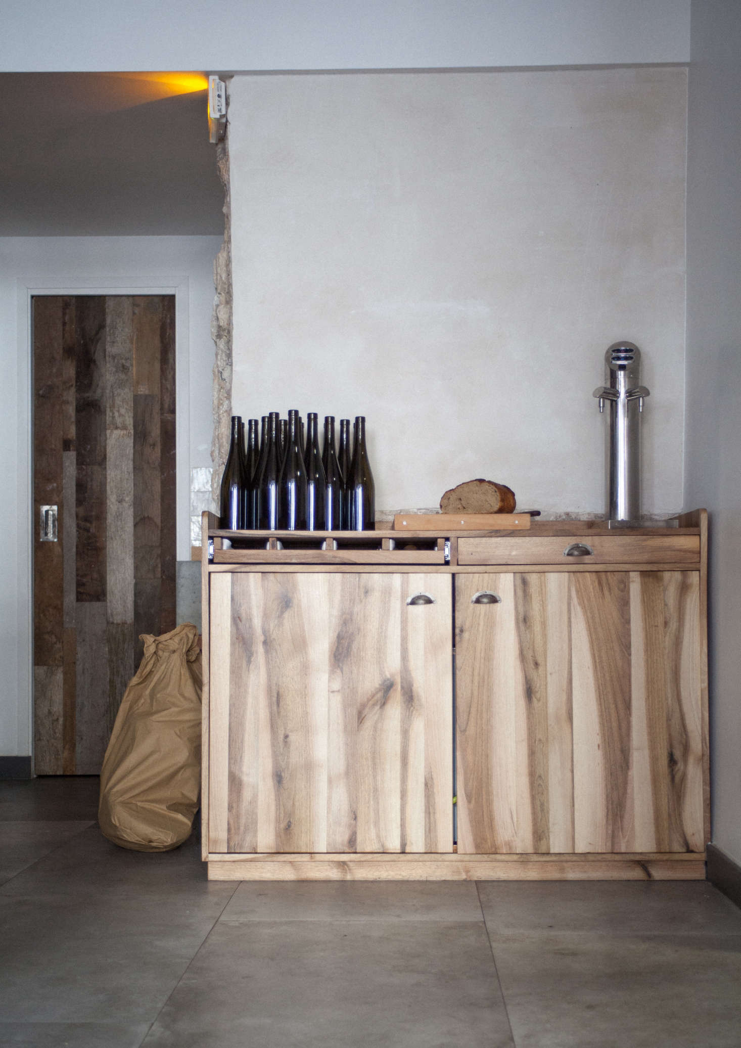 A reclaimed wood door and custom server station.